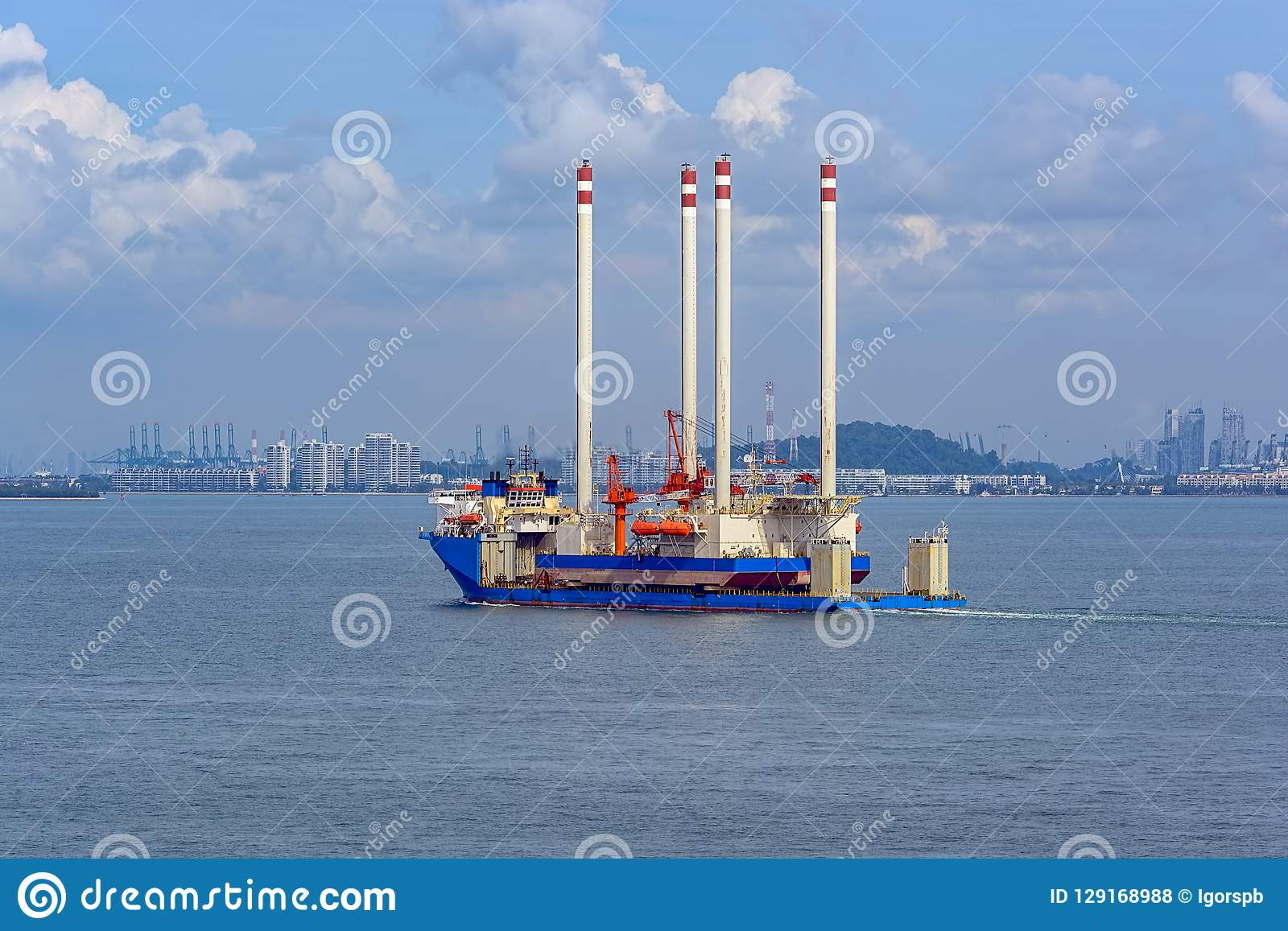 Heavy lift cargo ship transporting an oil rig platform