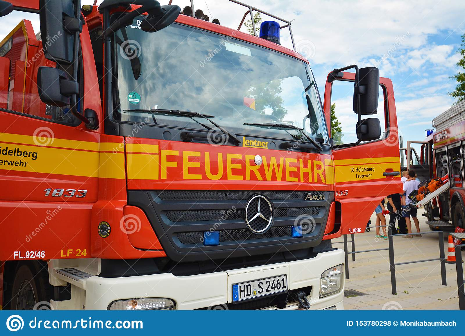 Front of red German fire truck with open front doors