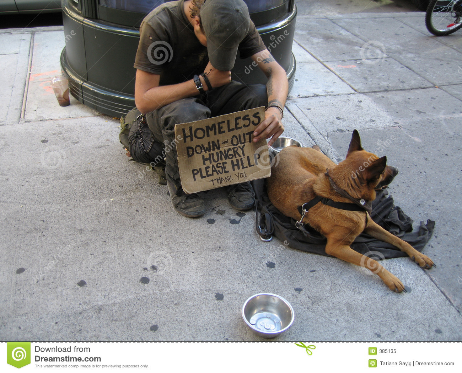 Heimatloser Mann mit Hund