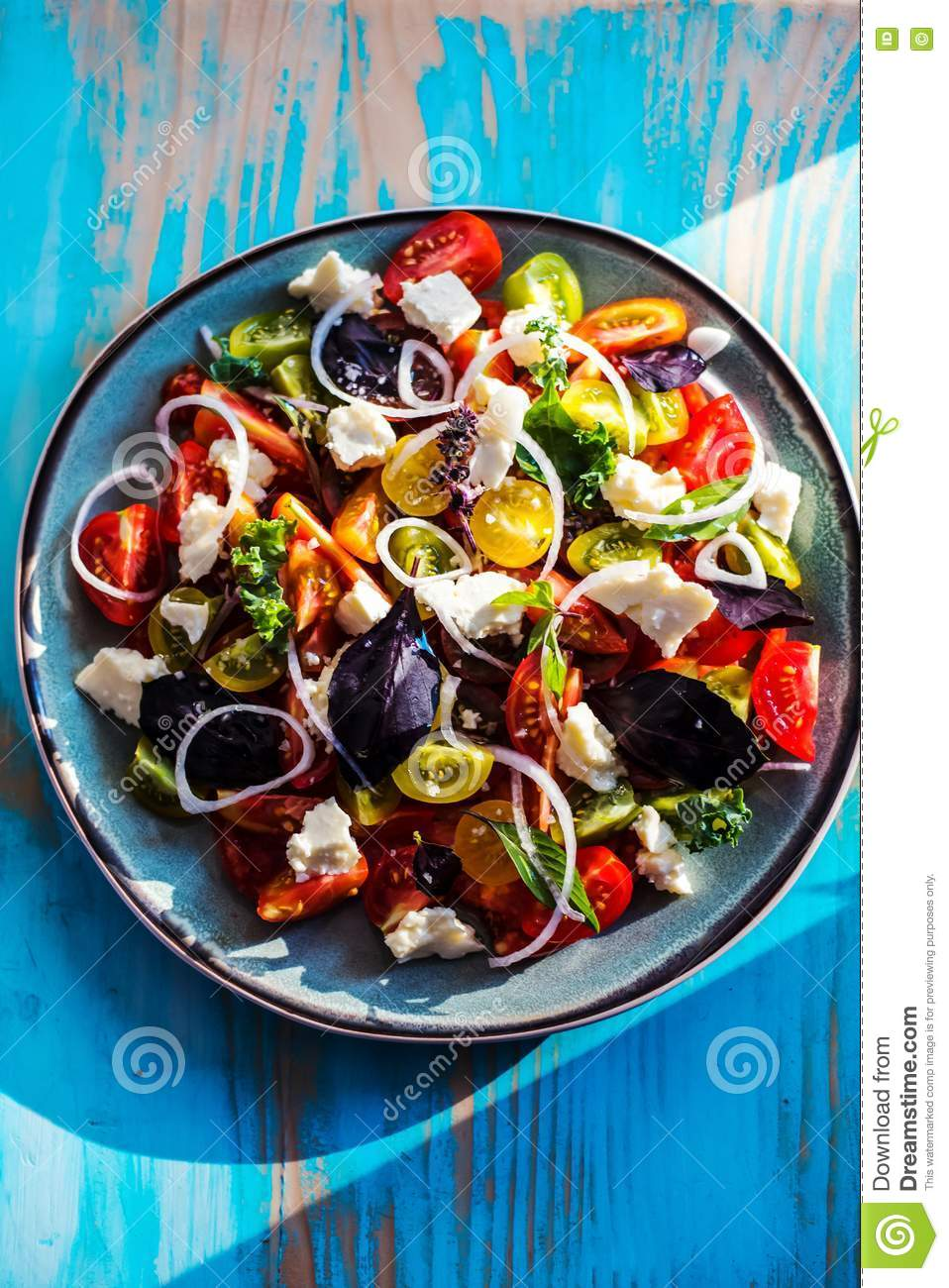 Heirloom tomatoes salad with cheese and basil