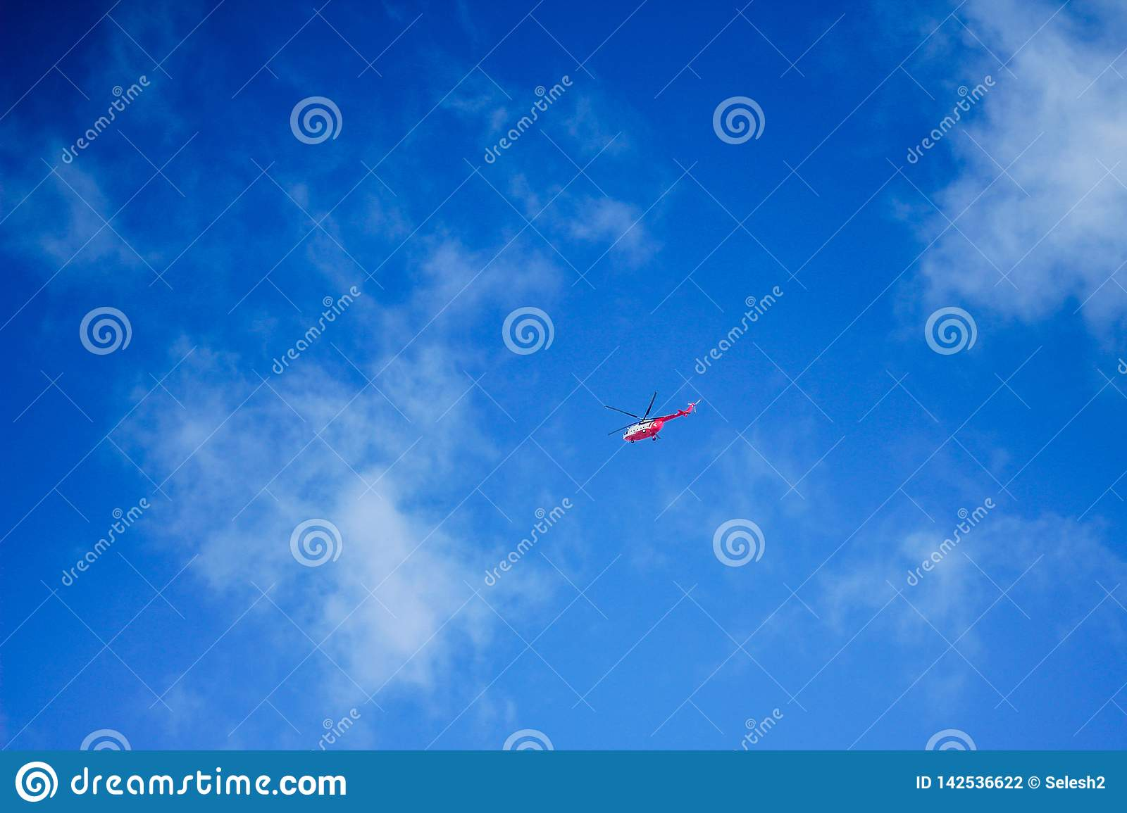 Helicopter in a blue sky.air transport.fly and speed