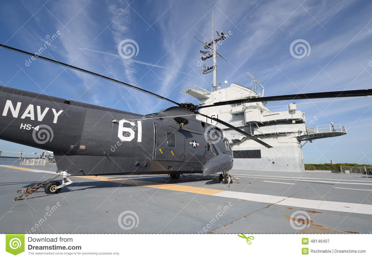helicopter on flight deck of aircraft carrier stock image