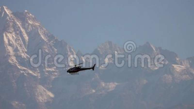 Helicopter Flying Over Himalayan Mountain Range. Shot with a Sony a6300 59,94 fps FHD stock footage
