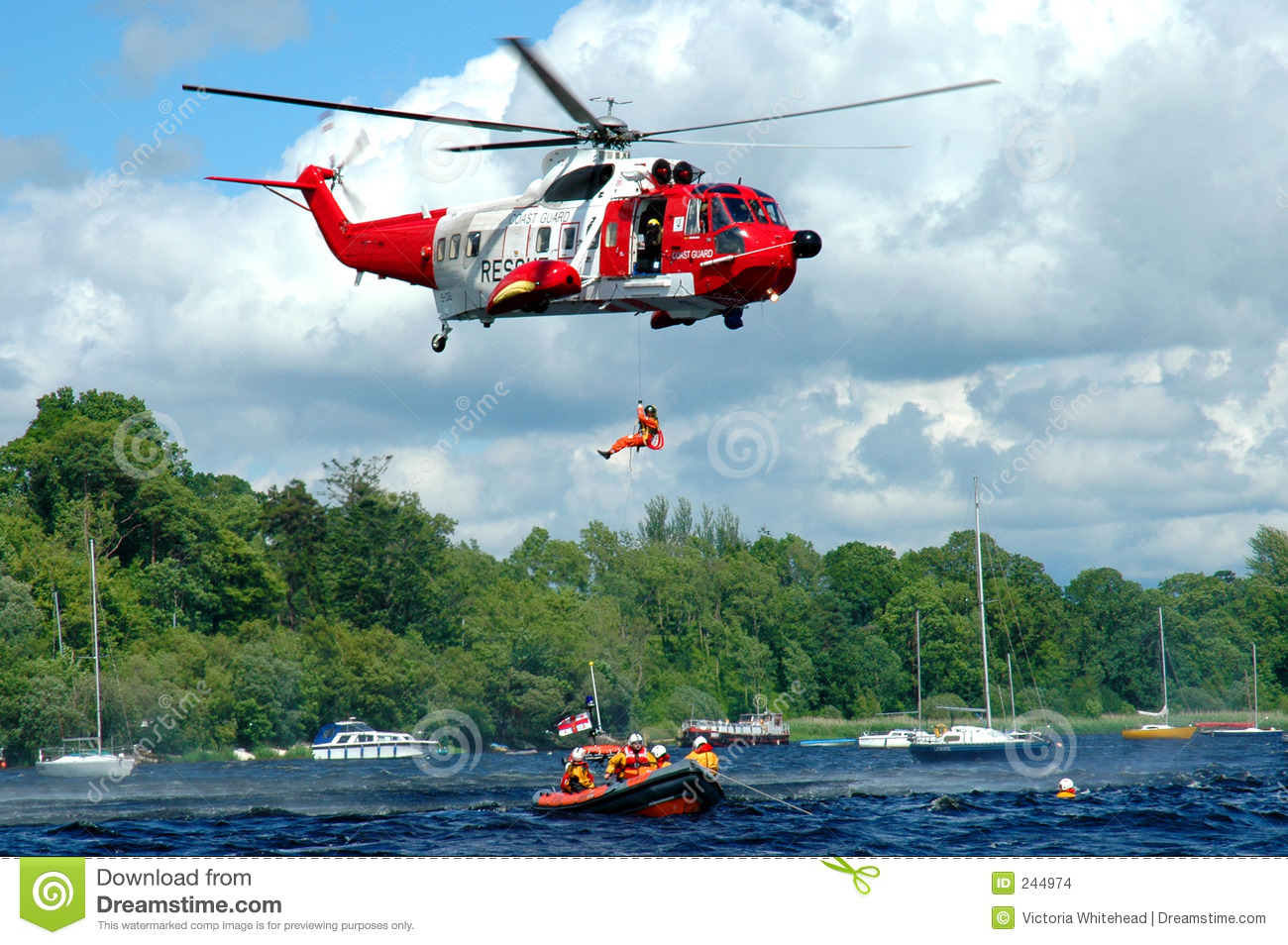 Helicopter Rescue, man being lowered towards water, rescue team ...