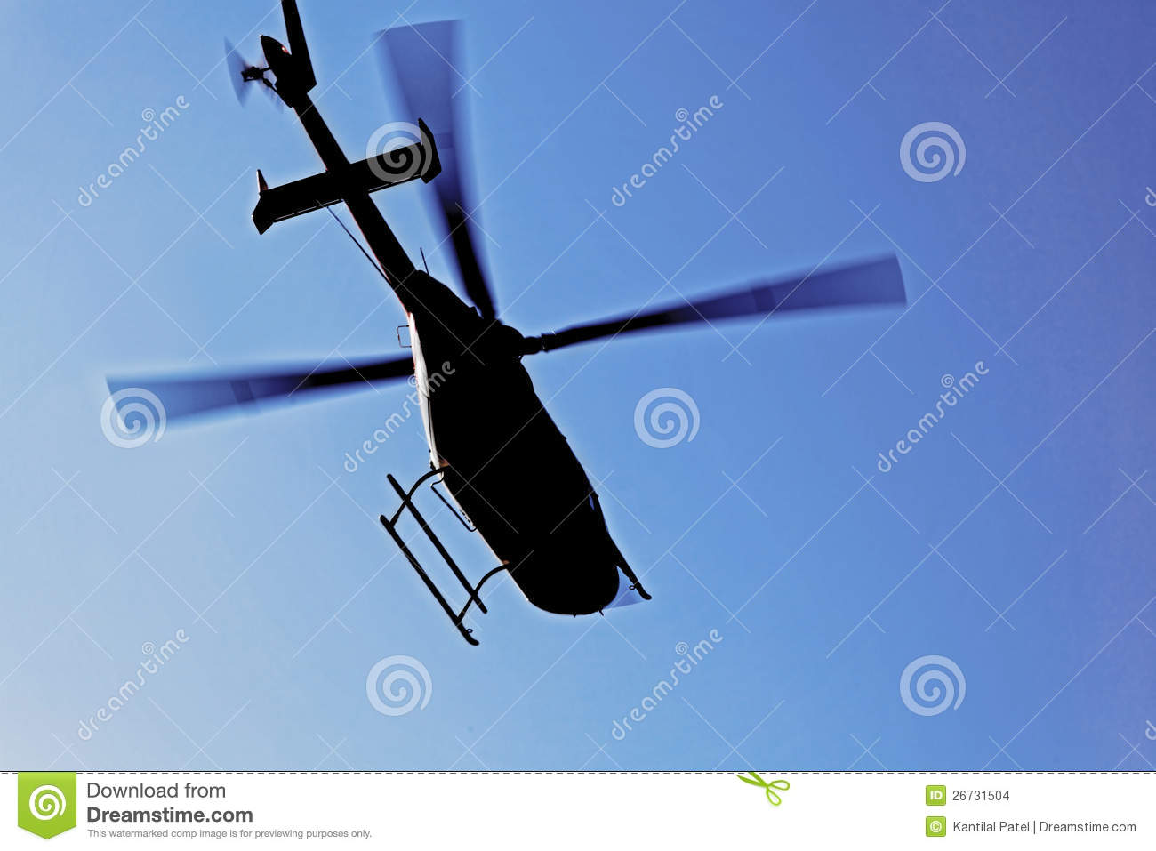 Helicopter silhouette in flight