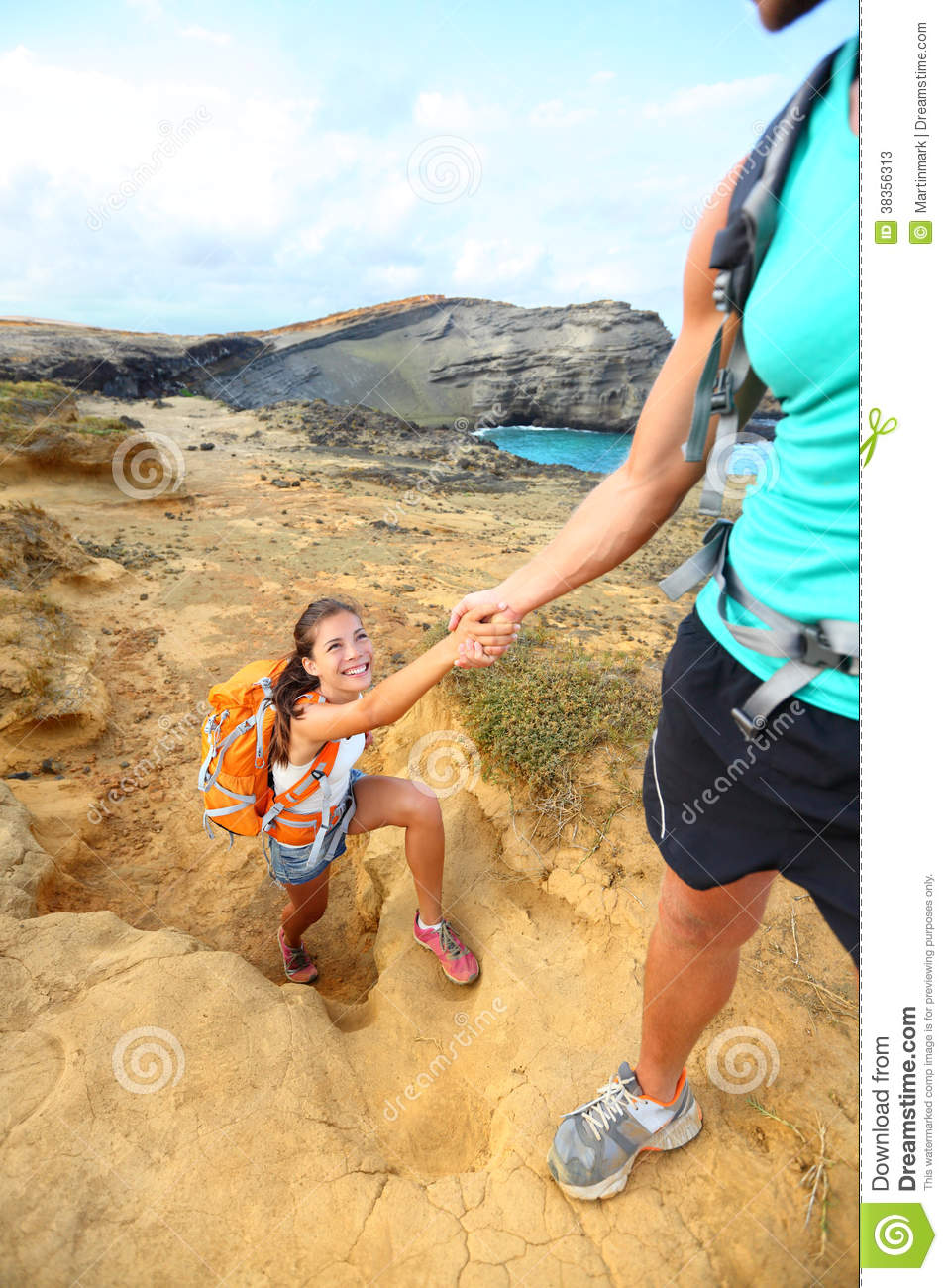 Help - hiker woman getting helping hand hiking