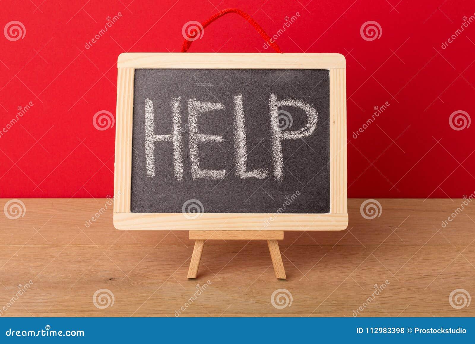 Help word written on school blackboard