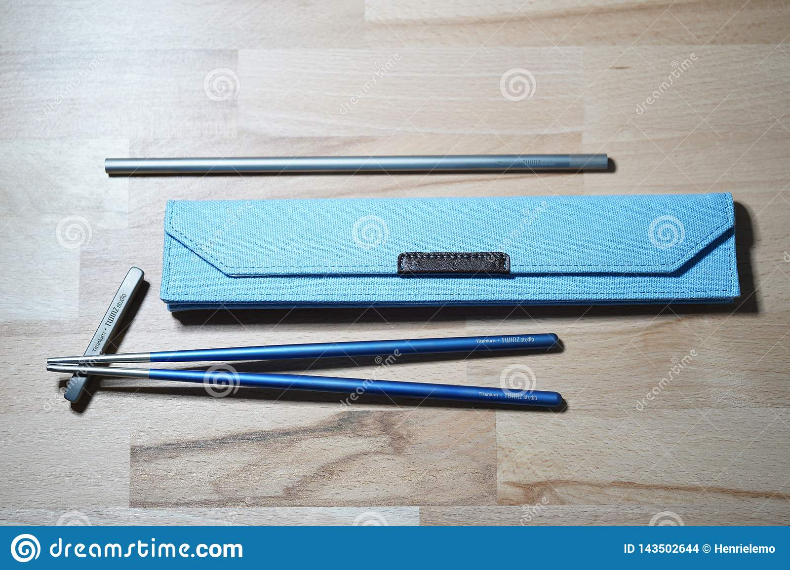 Helsinki, Finland - March 27, 2019: Chopsticks and straw made of titanium for sustainable purposes and not using plastic ones.