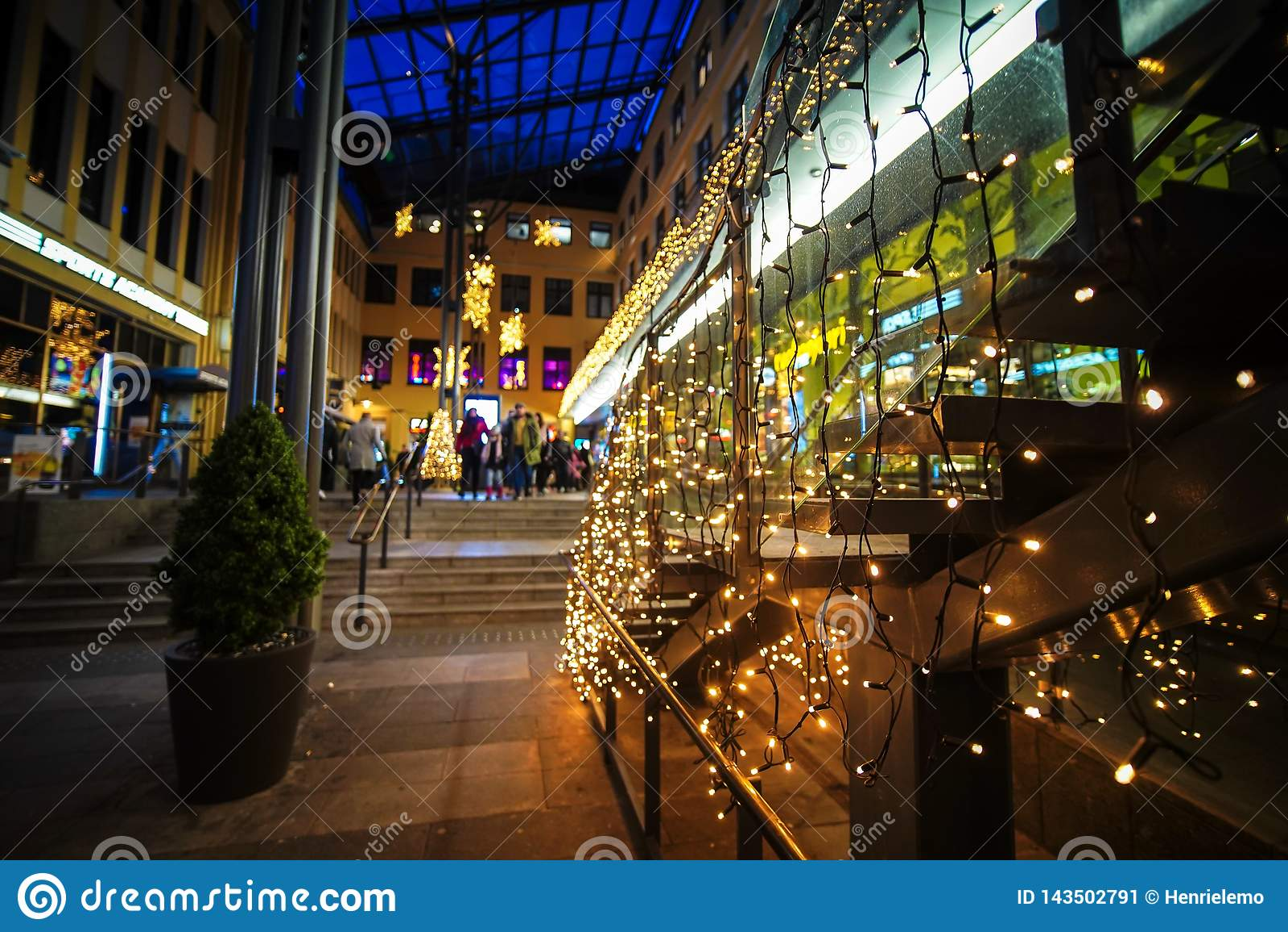 Helsinki, Finland - November 25, 2018: Shopping street on evening in middle of Helsinki with seasonal Christmas Lights