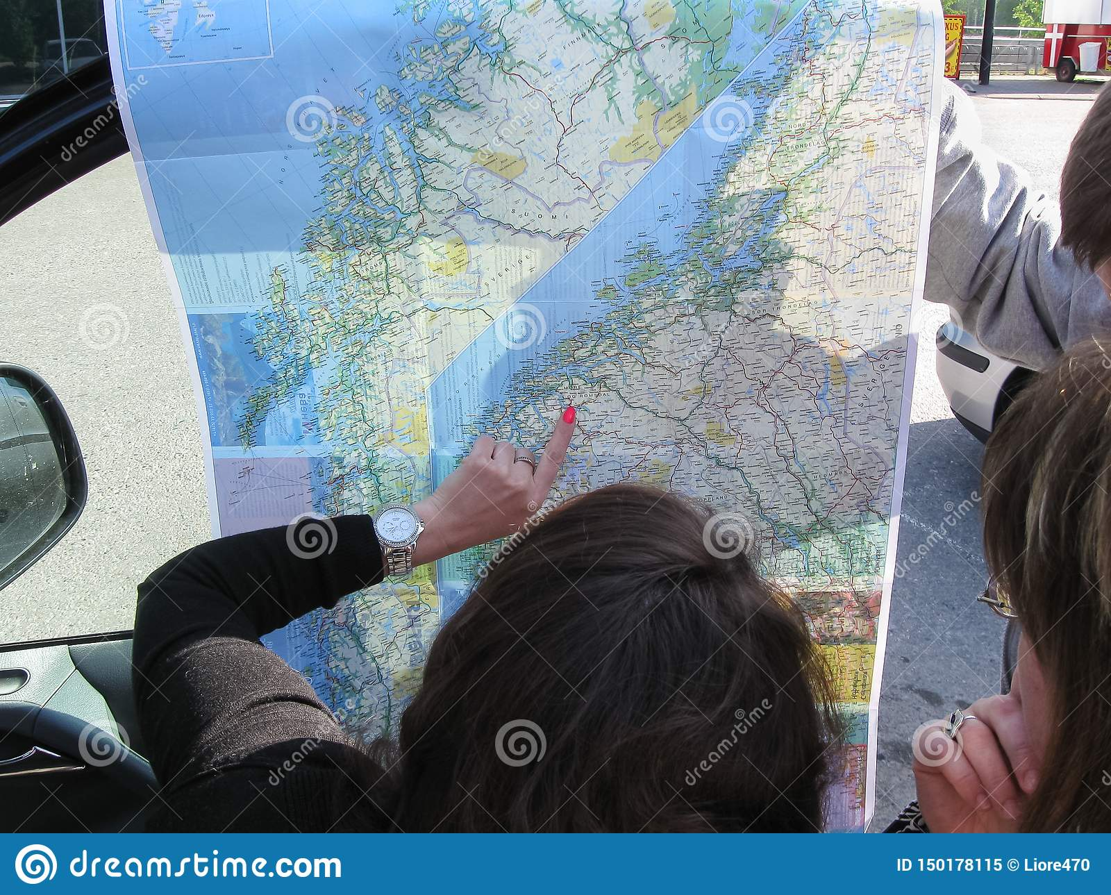 Helsinki, Finland - 11.06.2012: tourists view the map and make up the route