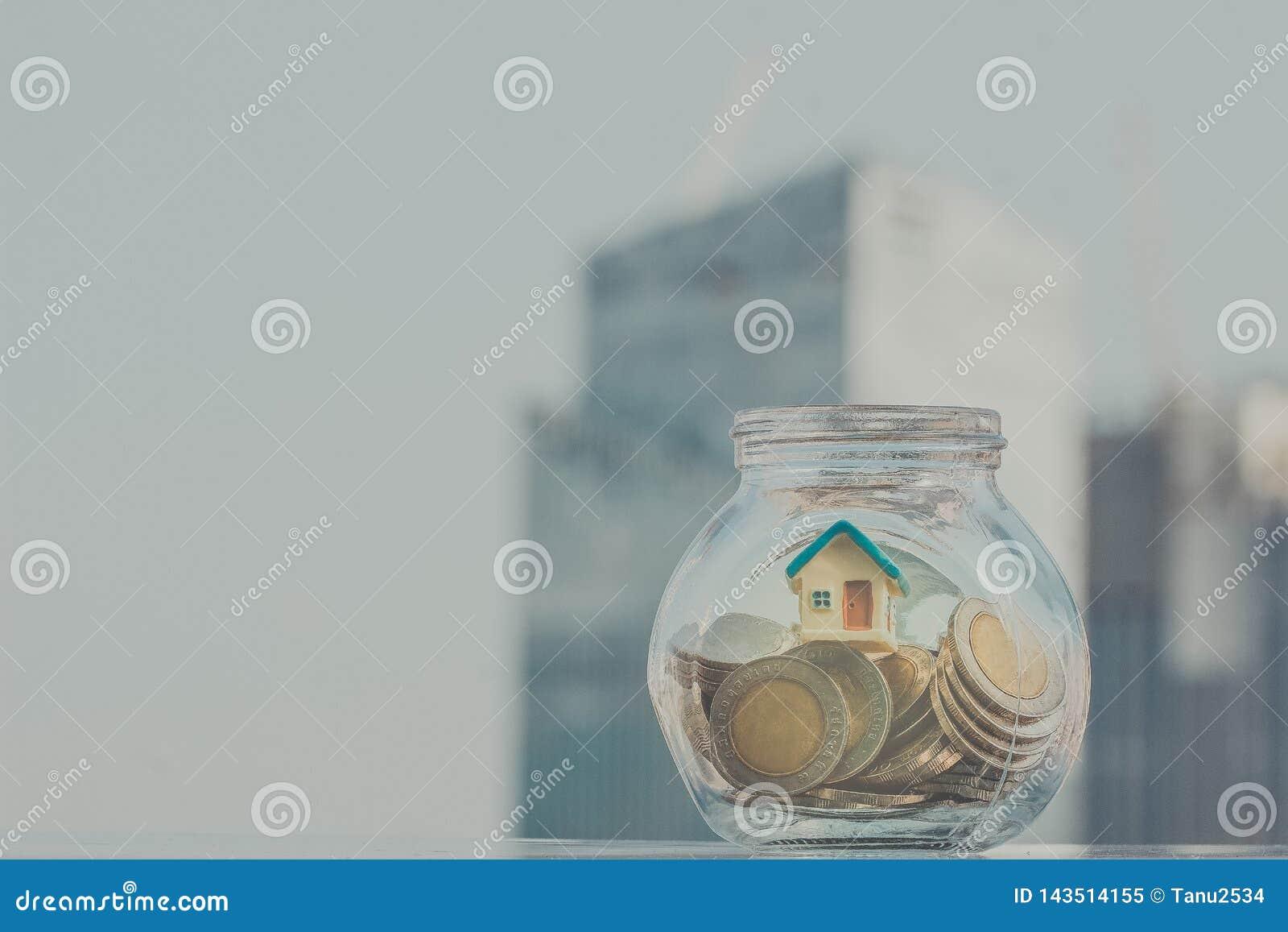 Hem- modell som sätts i flaskan Affär som är finansiell, besparingar