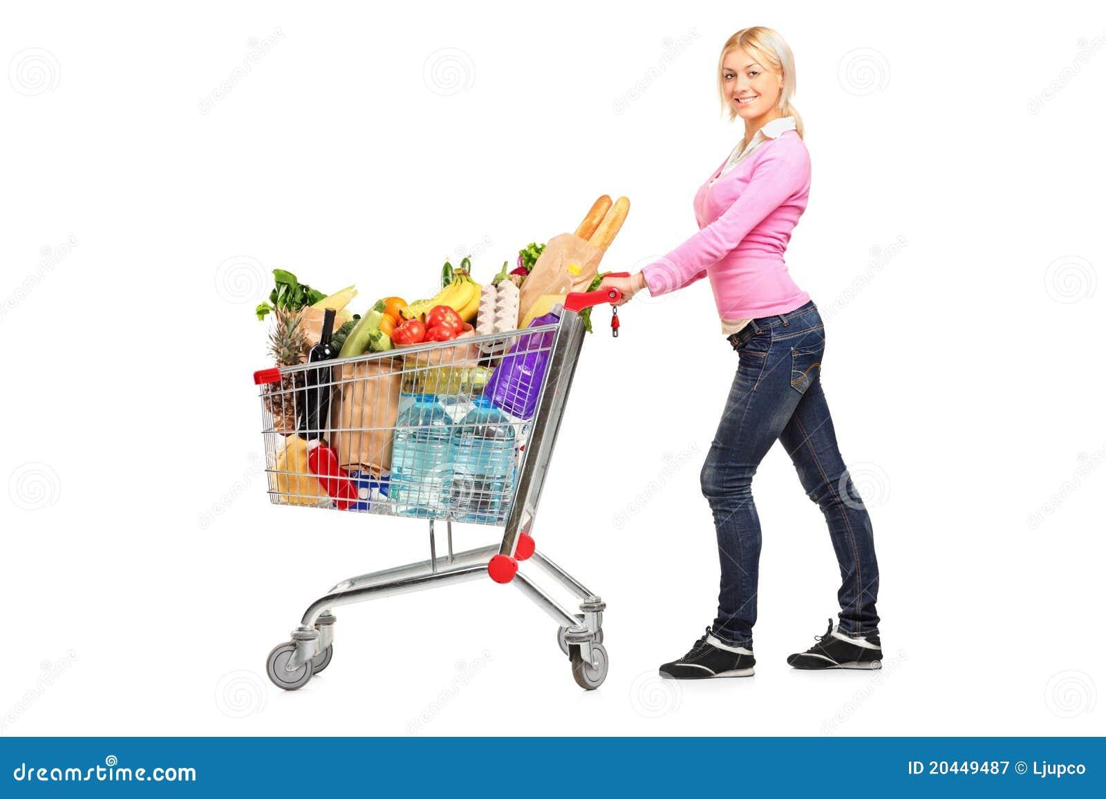 Hembra joven que empuja un carro de compras imagen de - Carrito dela compra ...