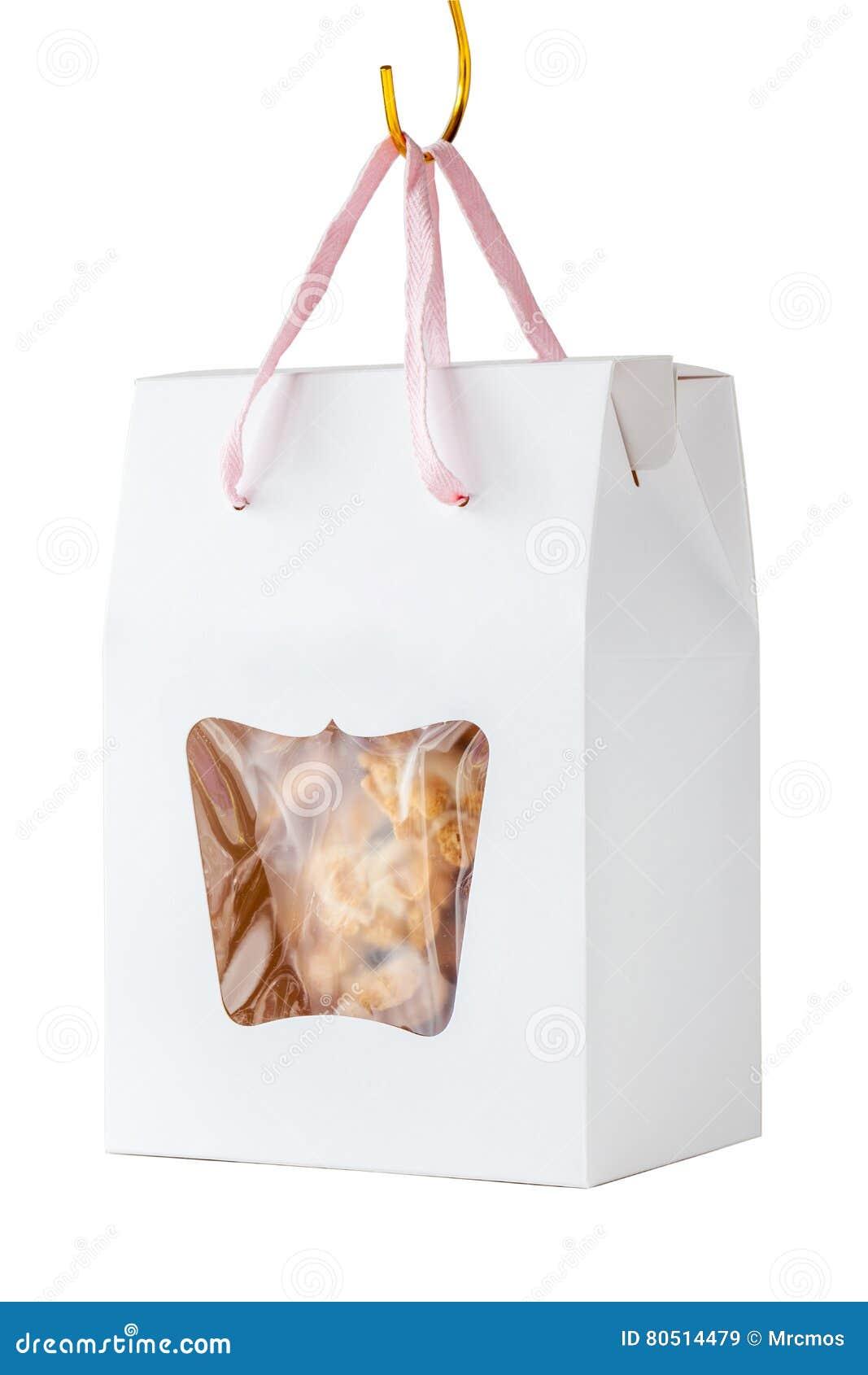 Hemlagade sädes- kakor i gåva för pappers- ask hänger på vita lodisar