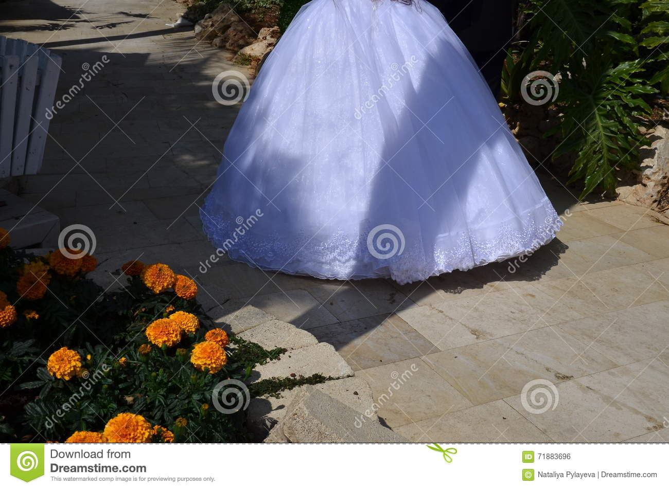 Hemline White Bride Dress In Shade In The Garden With Yellow Flowers