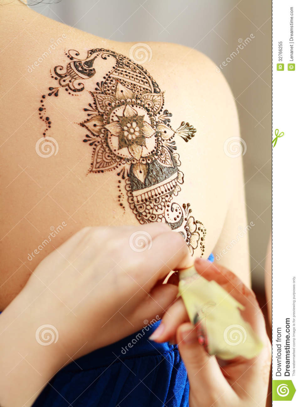 Henna applying on the back royalty free stock photo for Henna tattoo process