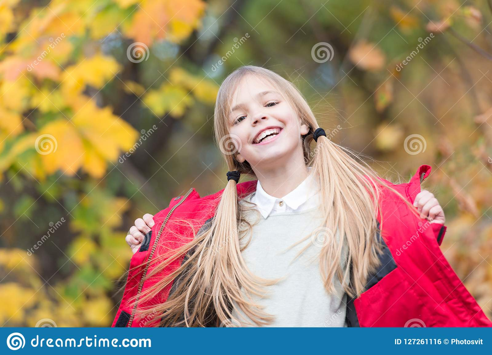 Kid girl wear coat for autumn season nature background child cheerful on fall walk warm coat best choice for autumn keep body warm clothes autumn days