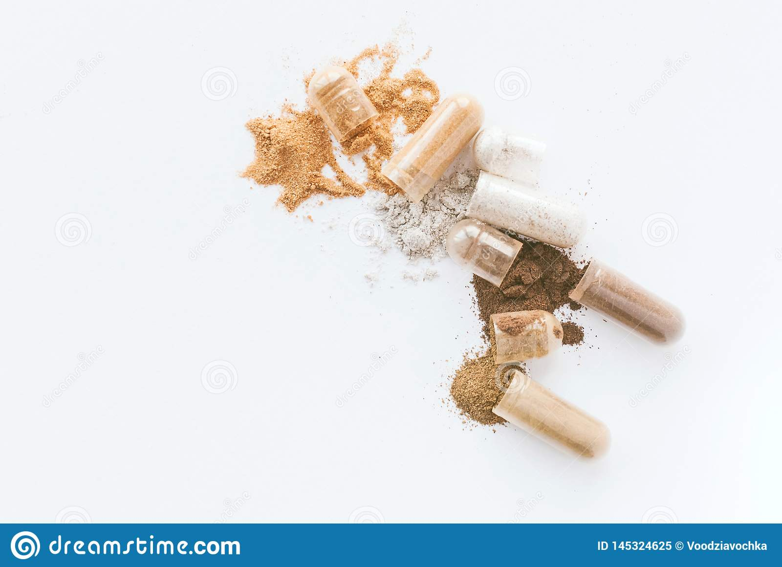 Herbal pills. Open Herbal capsules and powder on white background. Copyspace