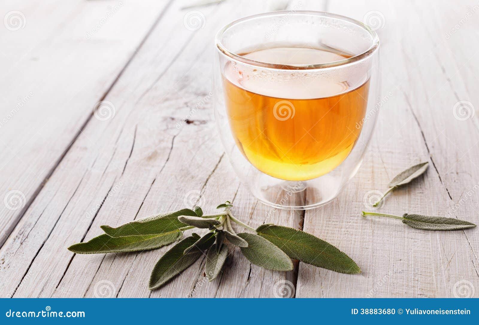 Herbal sage tea on wooden background