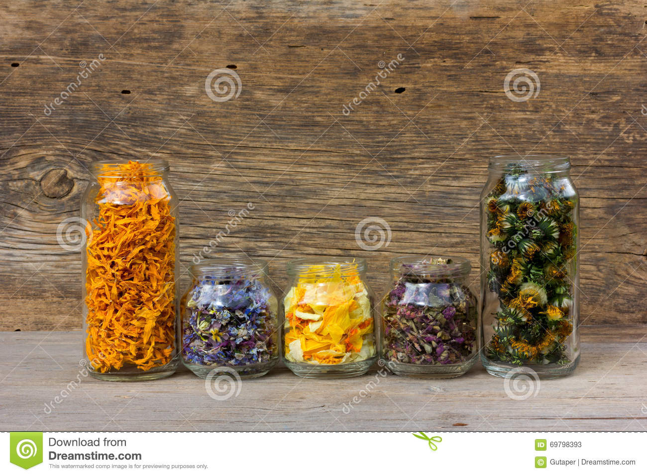 Herbs and flower petals in glass jar