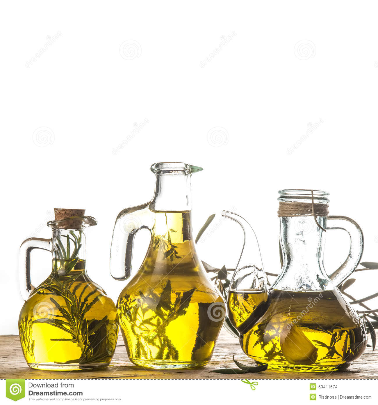 Rosemary, garlic and herbs infused olive oil in rustic glass bottles.