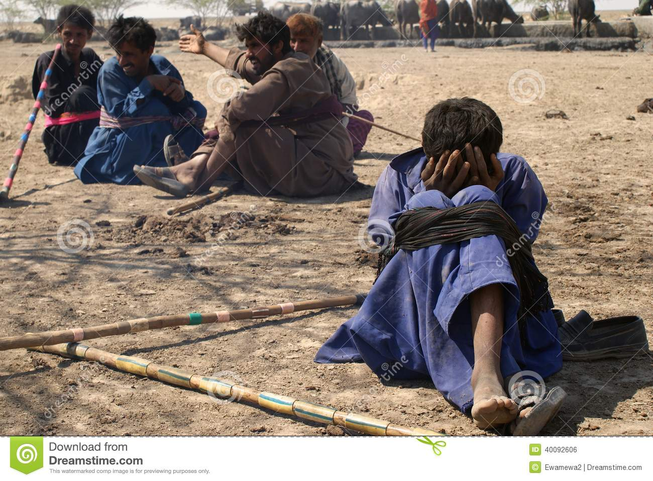 Herdsman Sitting With Tied Knees In The Desert Of ...