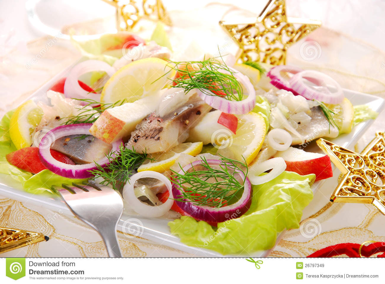 Herring salad with apple,red onion and lemon for christmas.