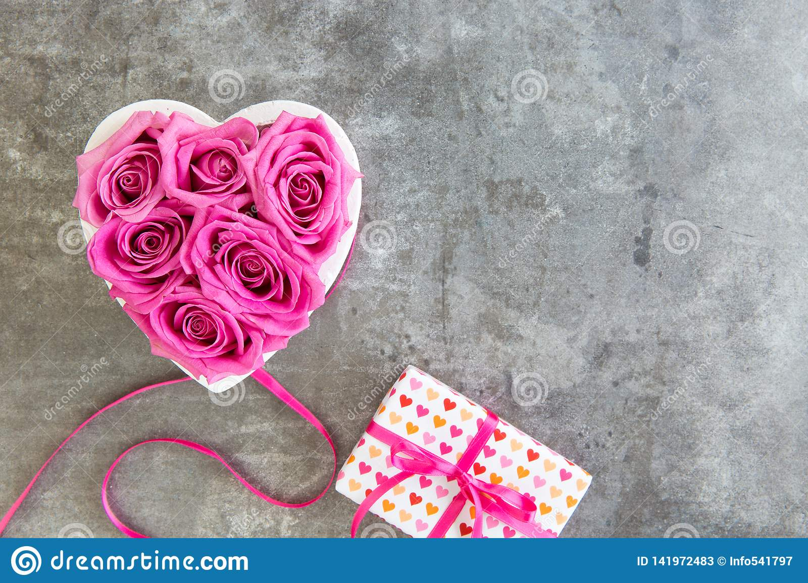 Heart of roses in pink and gift box with bow, Mother`s Day