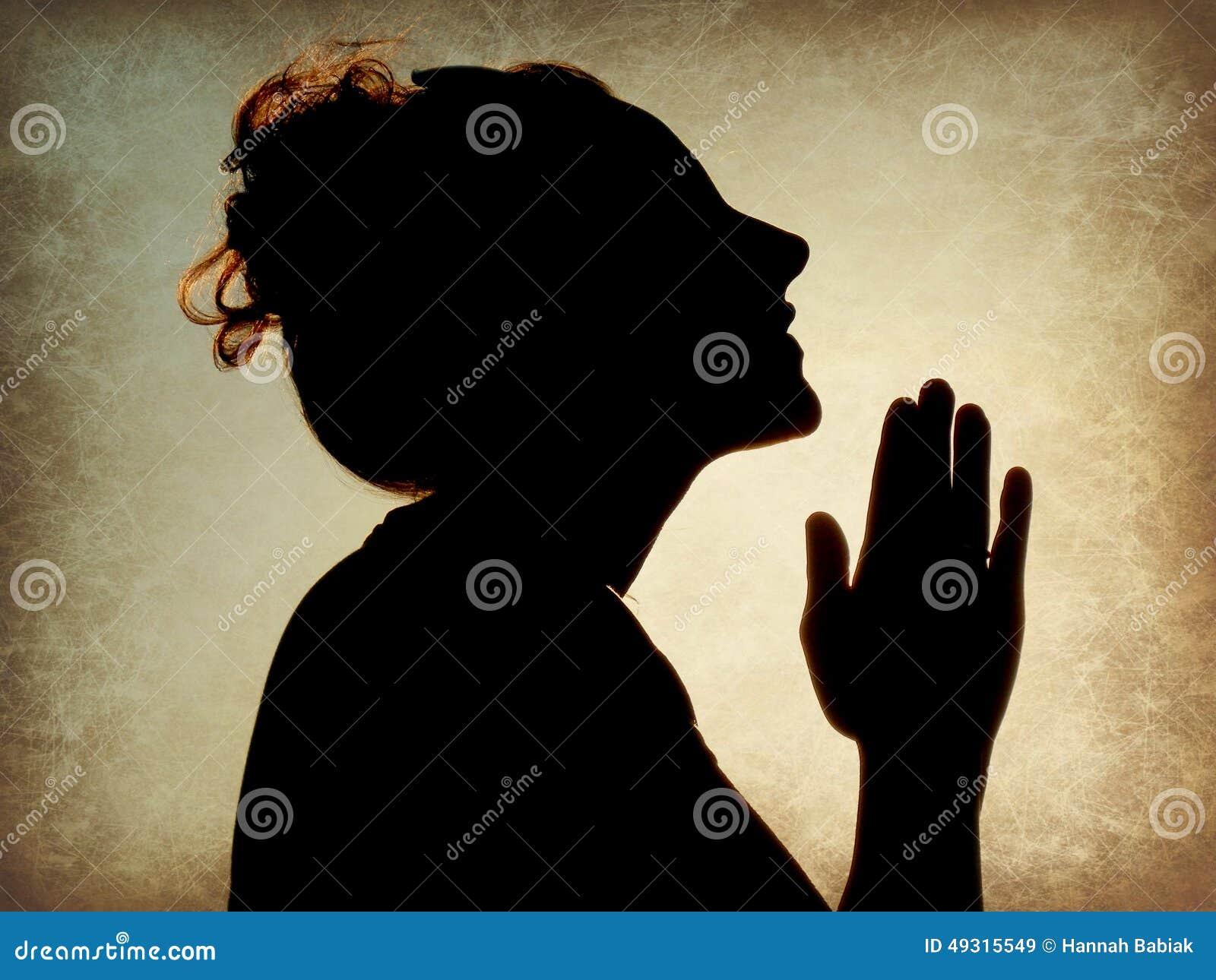 Het bidden van de vrouw silhouet