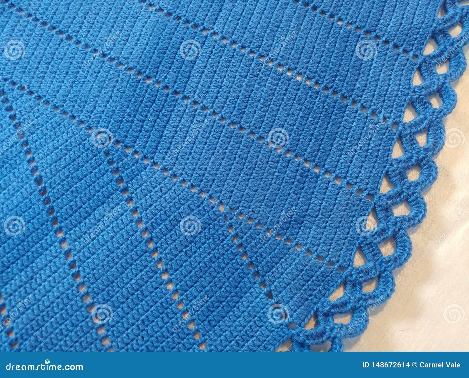 Het blauw haakt tafelkleed