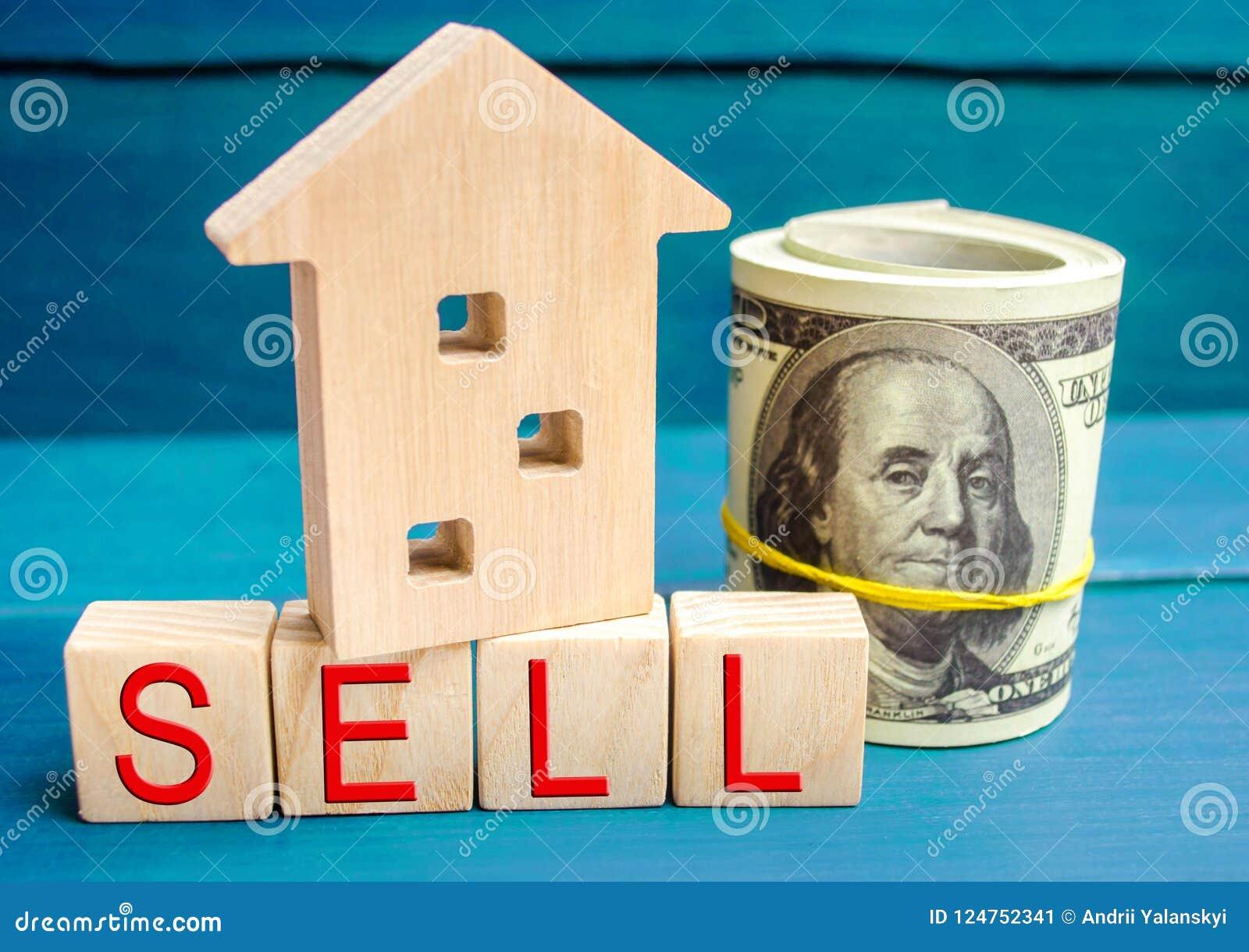 Het blokhuis op een blauwe achtergrond met de inschrijving verkoopt verkoop van bezit, onroerende goederen huis, Betaalbare huisv
