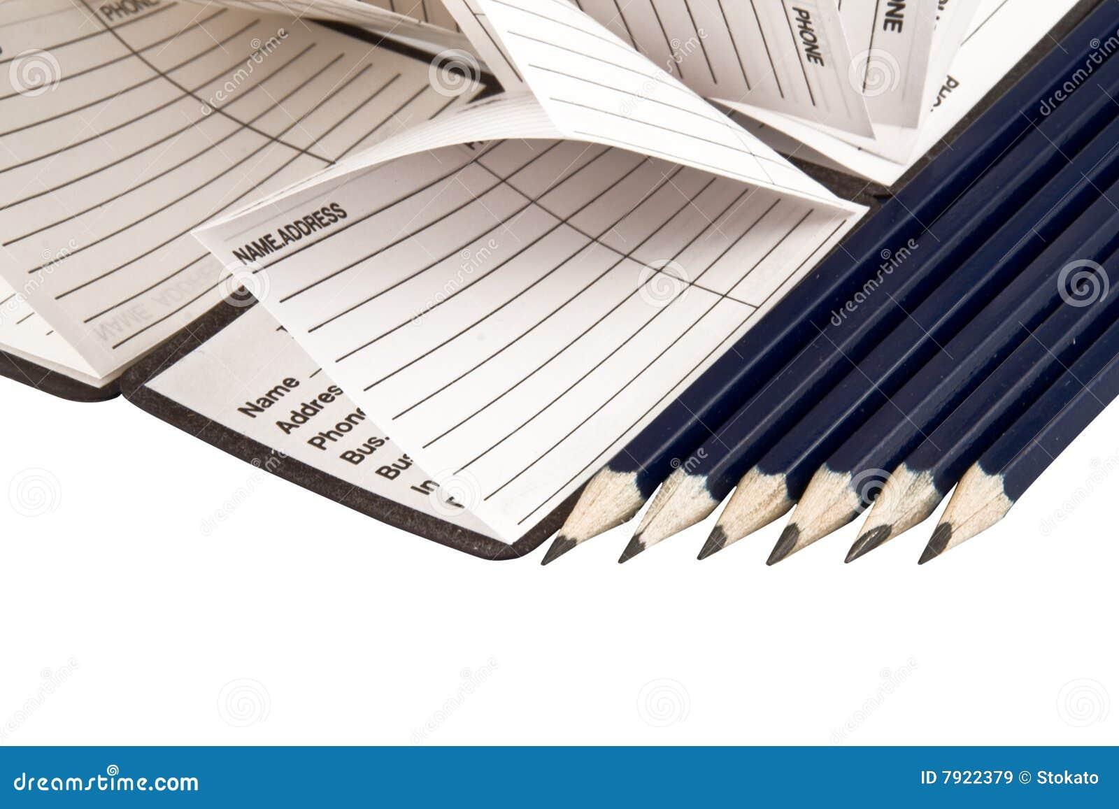 Het boek van het adres en potloden