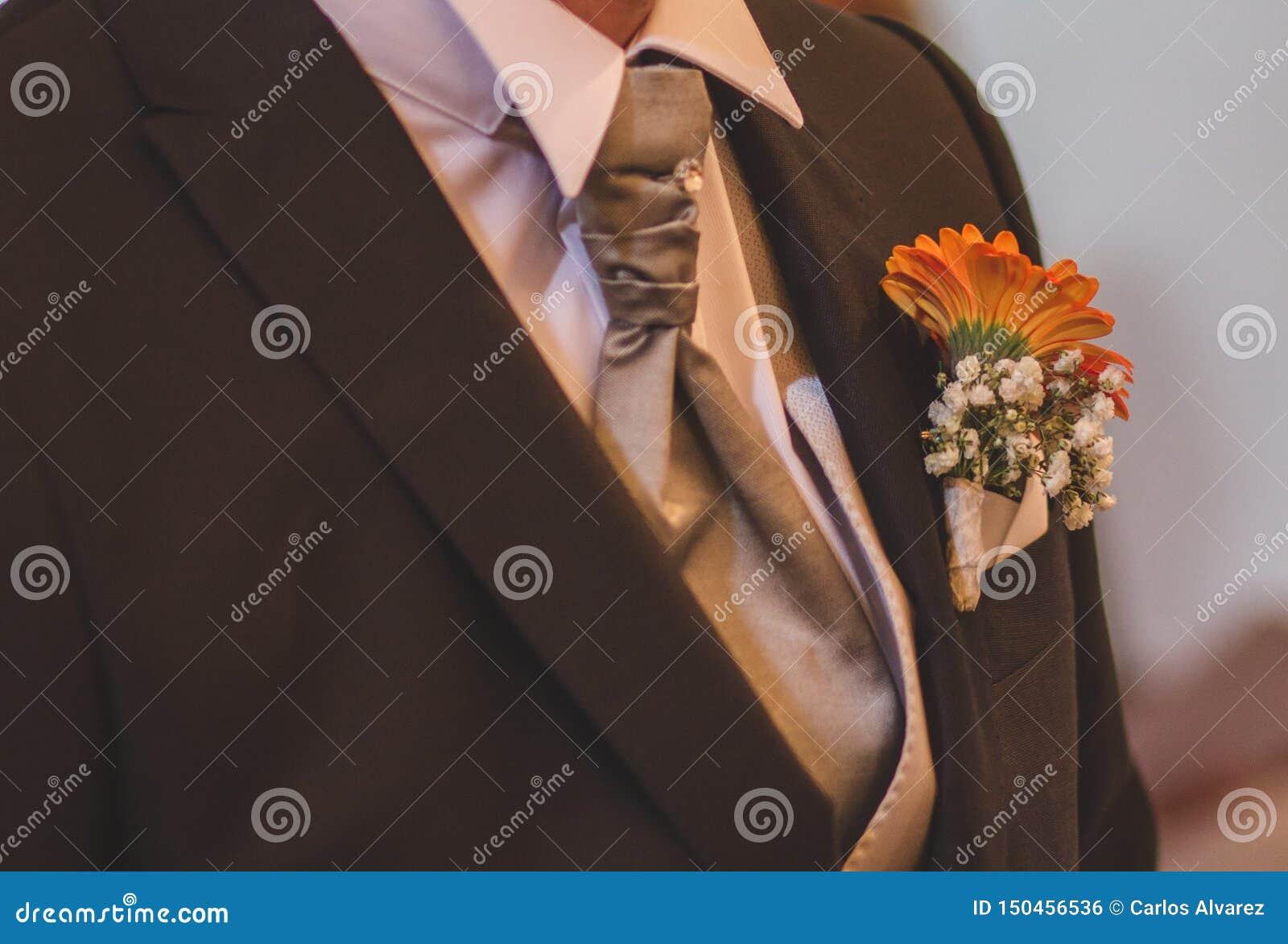 Het boeket van de bruidegom met band