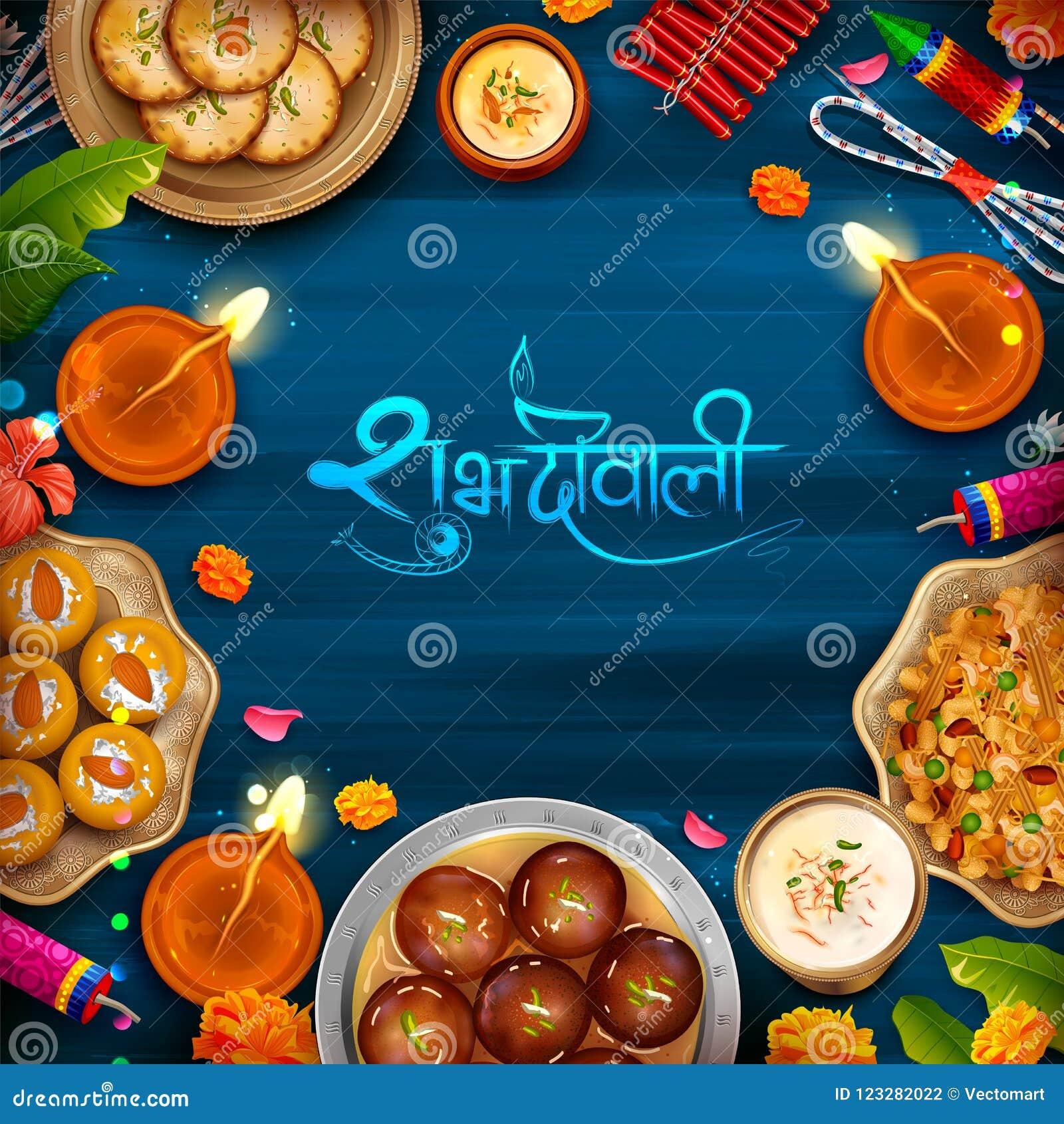 Het branden diya met geassorteerd snoepje en snack op Gelukkige Diwali-Vakantieachtergrond voor licht festival van India