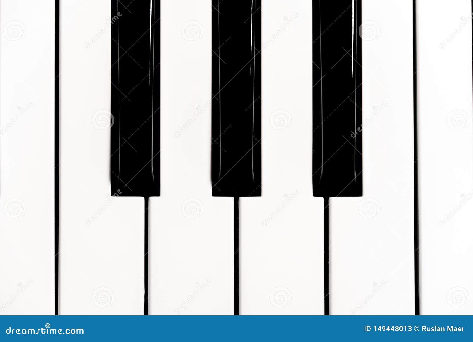 Het close-up van het pianotoetsenbord