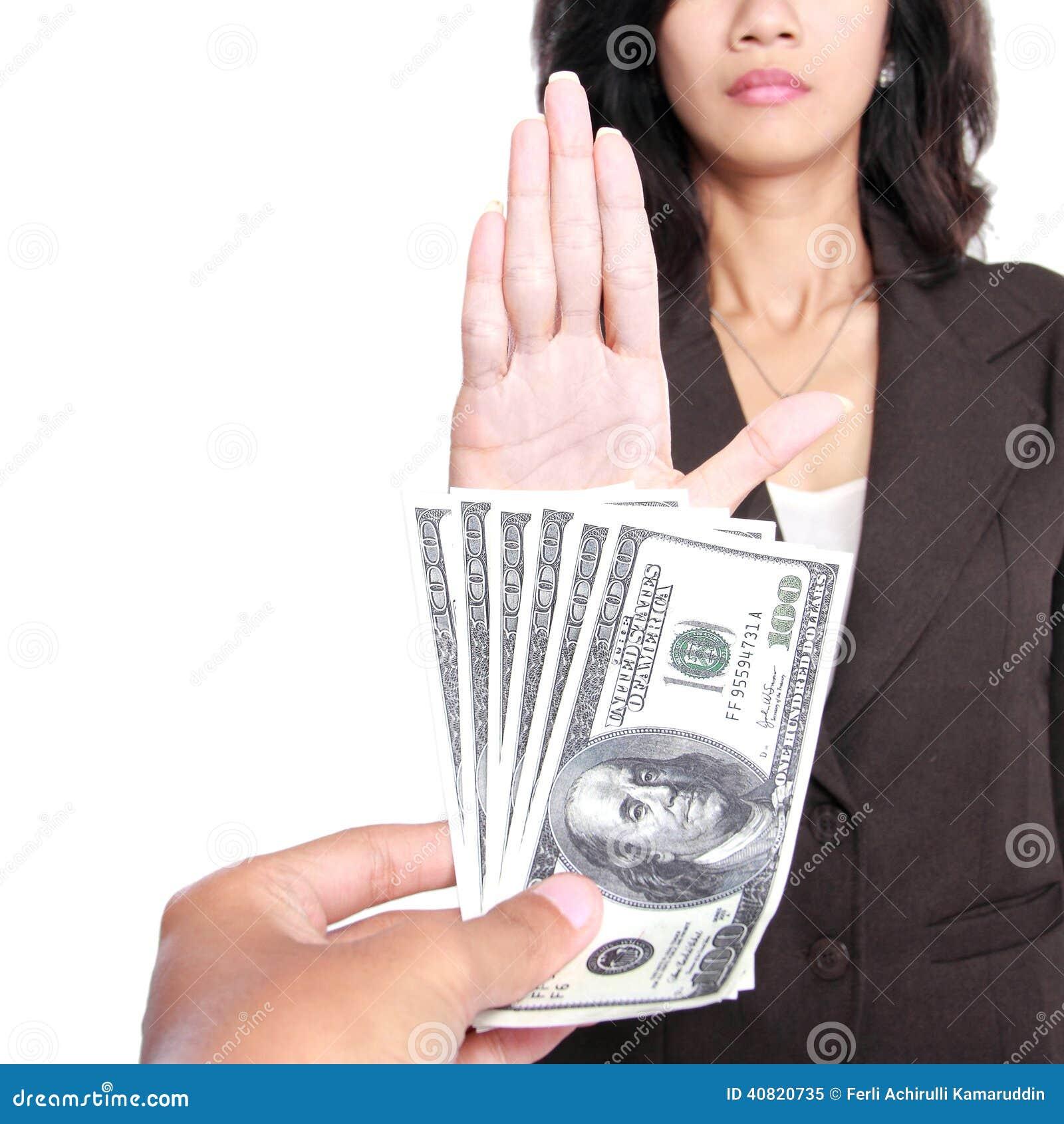 Het conceptuele beeld van hand geeft geld voor corruptie