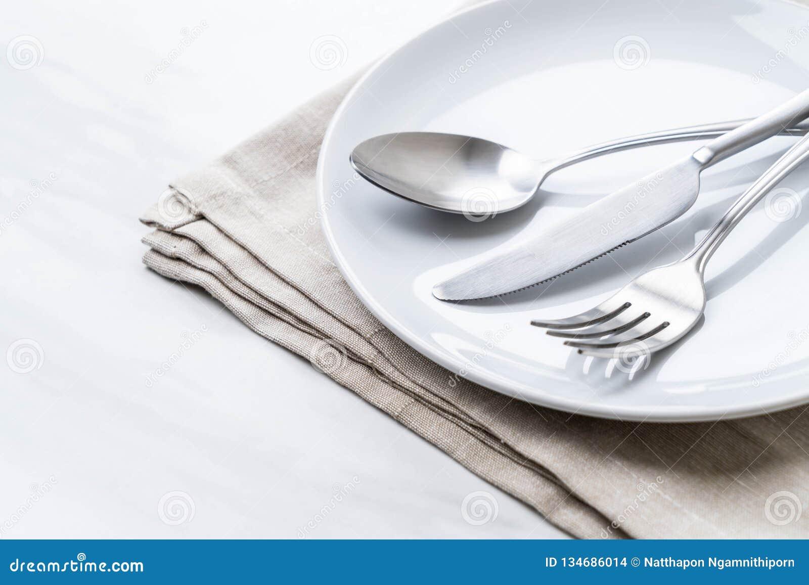 Het de lege vork en mes van de plaatlepel
