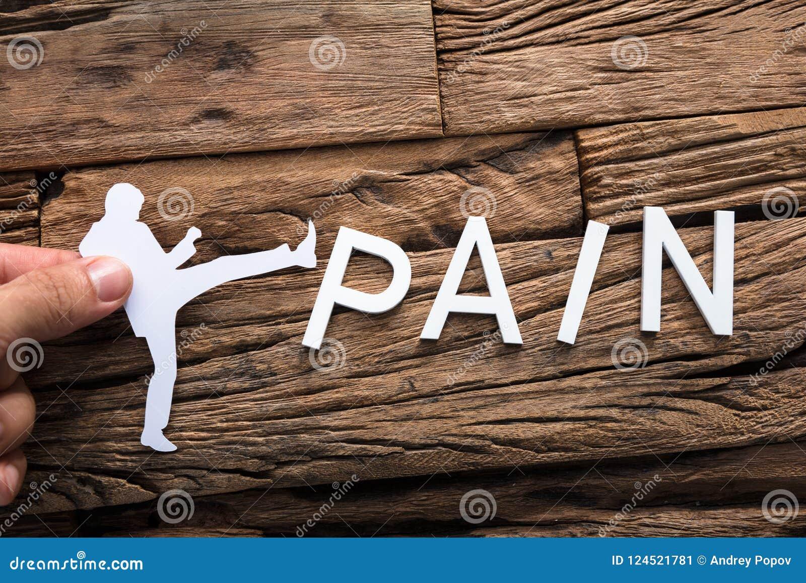 Het Document van de handholding Zakenman Kicking Word Pain