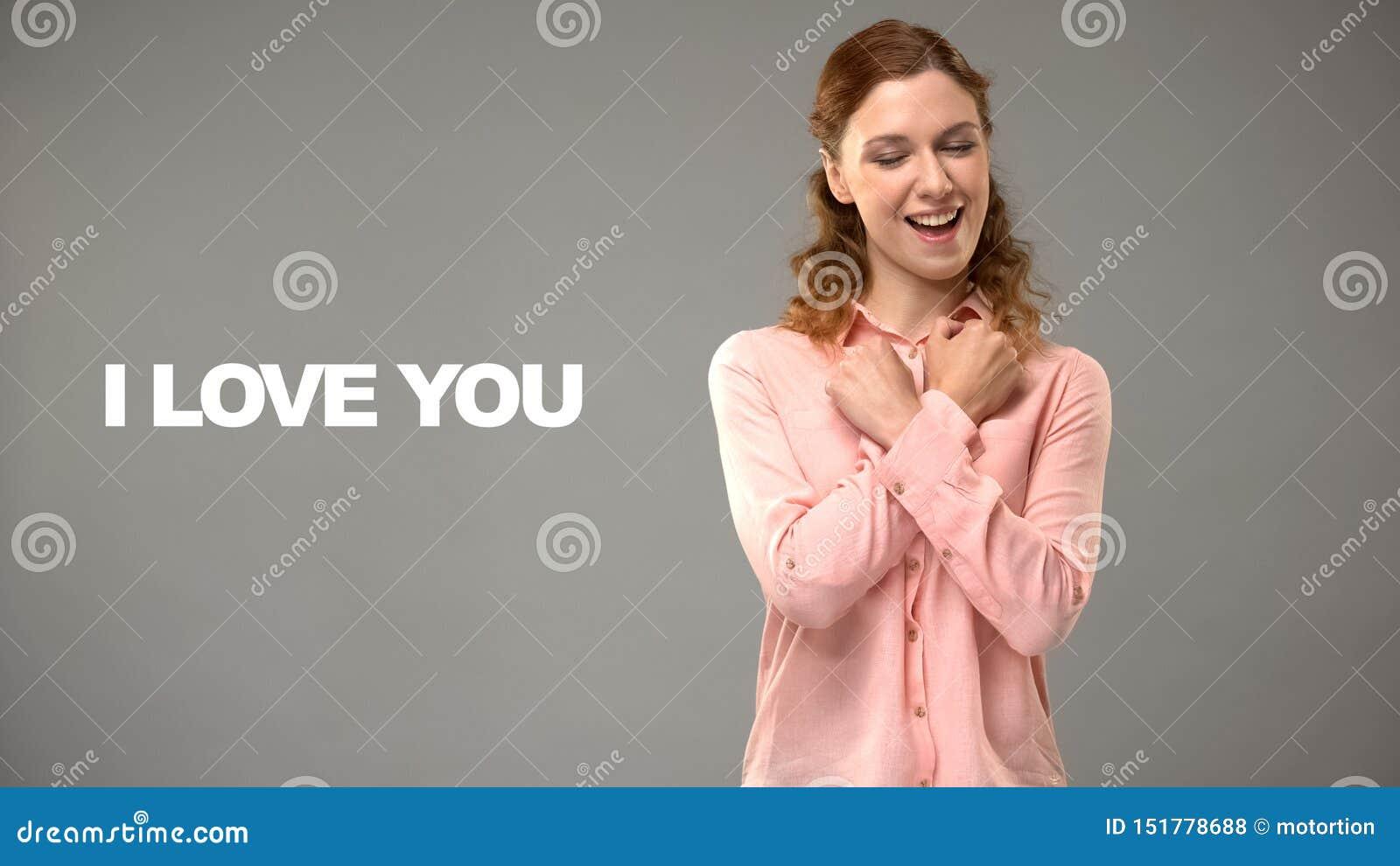 Het dove vrouw zeggen houdt van u in gebarentaal, tekst op achtergrond, mededeling
