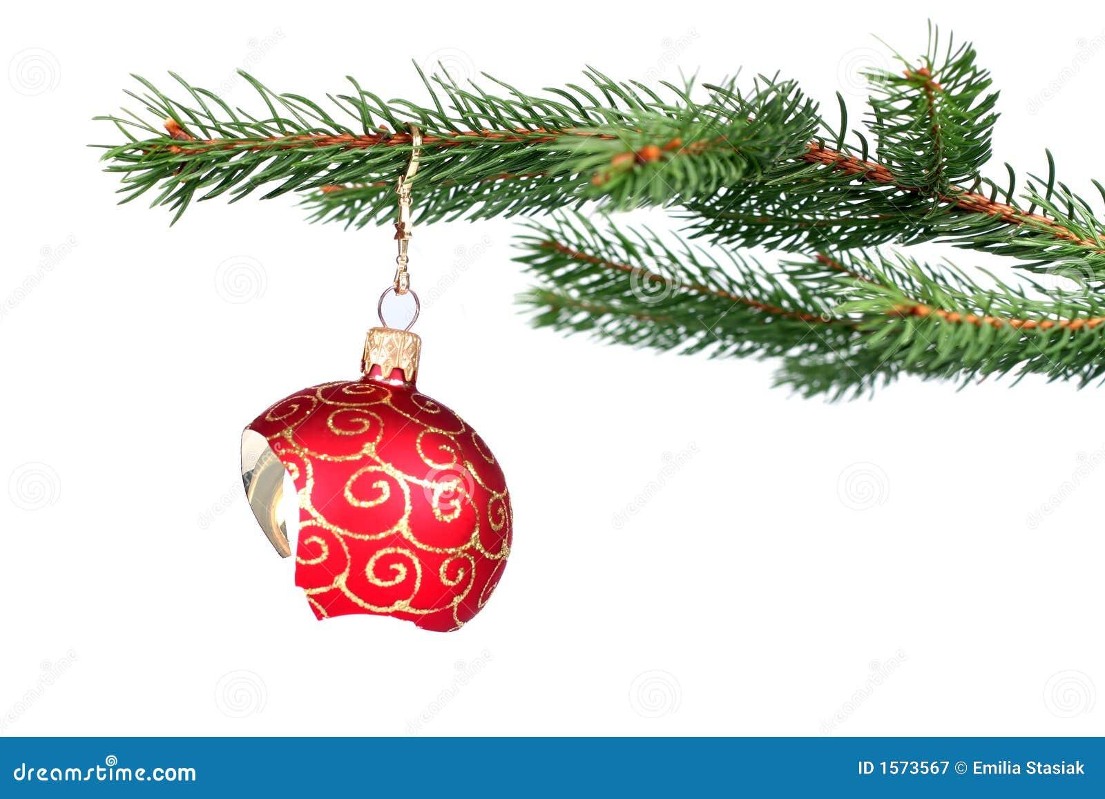 Het gebroken de decoratie van Kerstmis hangen op een boom