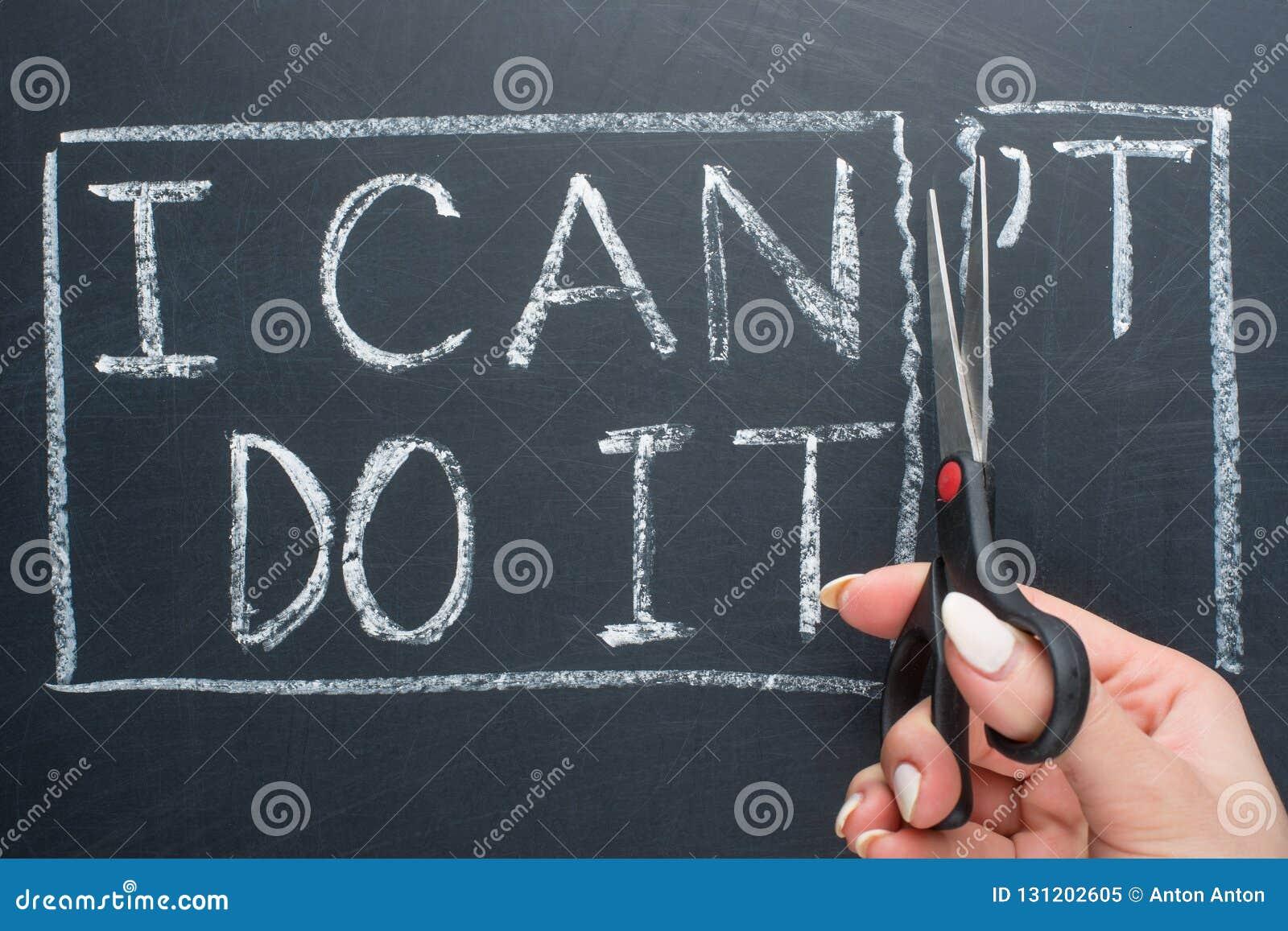 Het gebruiken van schaar om het woord te verwijderen kan & x27; te lezen t kan ik het doen concept voor zelfgeloof, positieve hou