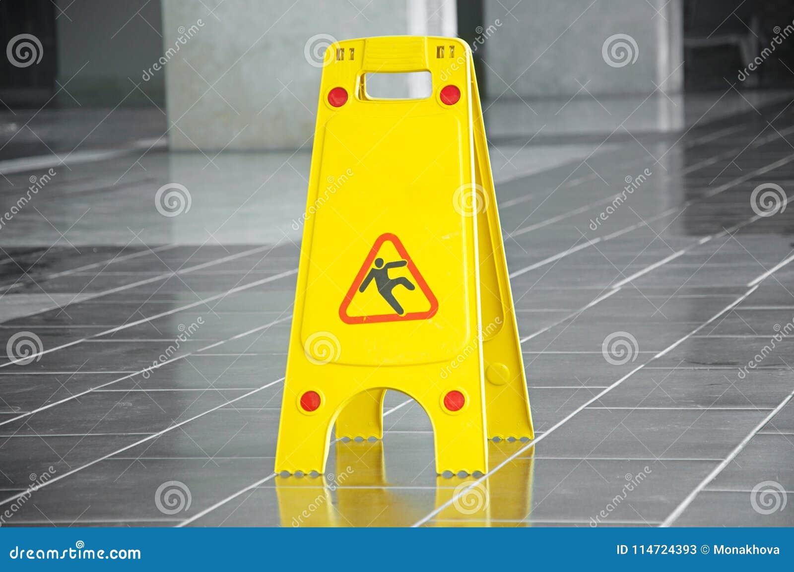 Het het gladde waarschuwingsbord en symbool van de vloeroppervlakte in de bouw, zaal