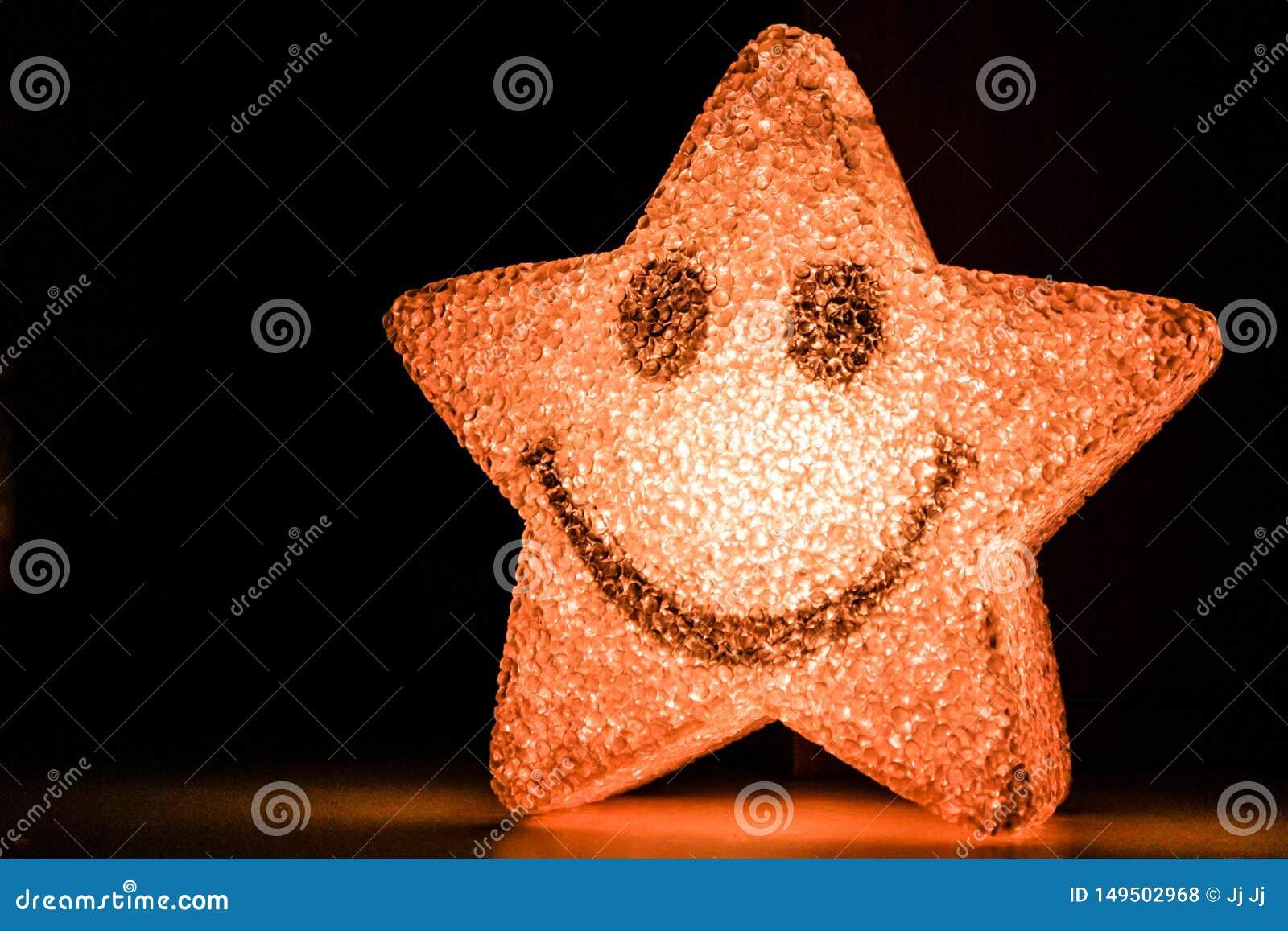 Het glimlachen ster het glanzen