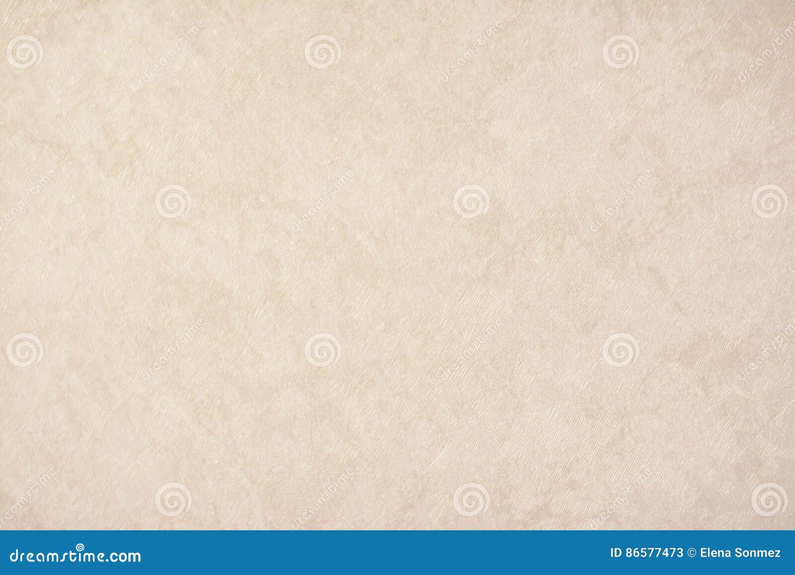 Het gouden textuurdocument als achtergrond in gele uitstekende room of het beige kleurt, perkamentdocument, abstracte pastelkleur