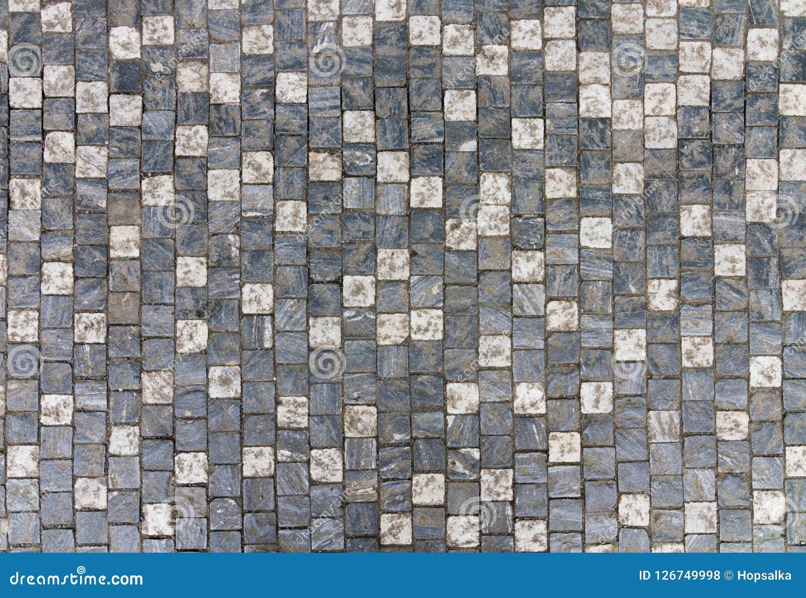Het graniet cobblestoned bestratingsachtergrond met regelmatig ontwerp