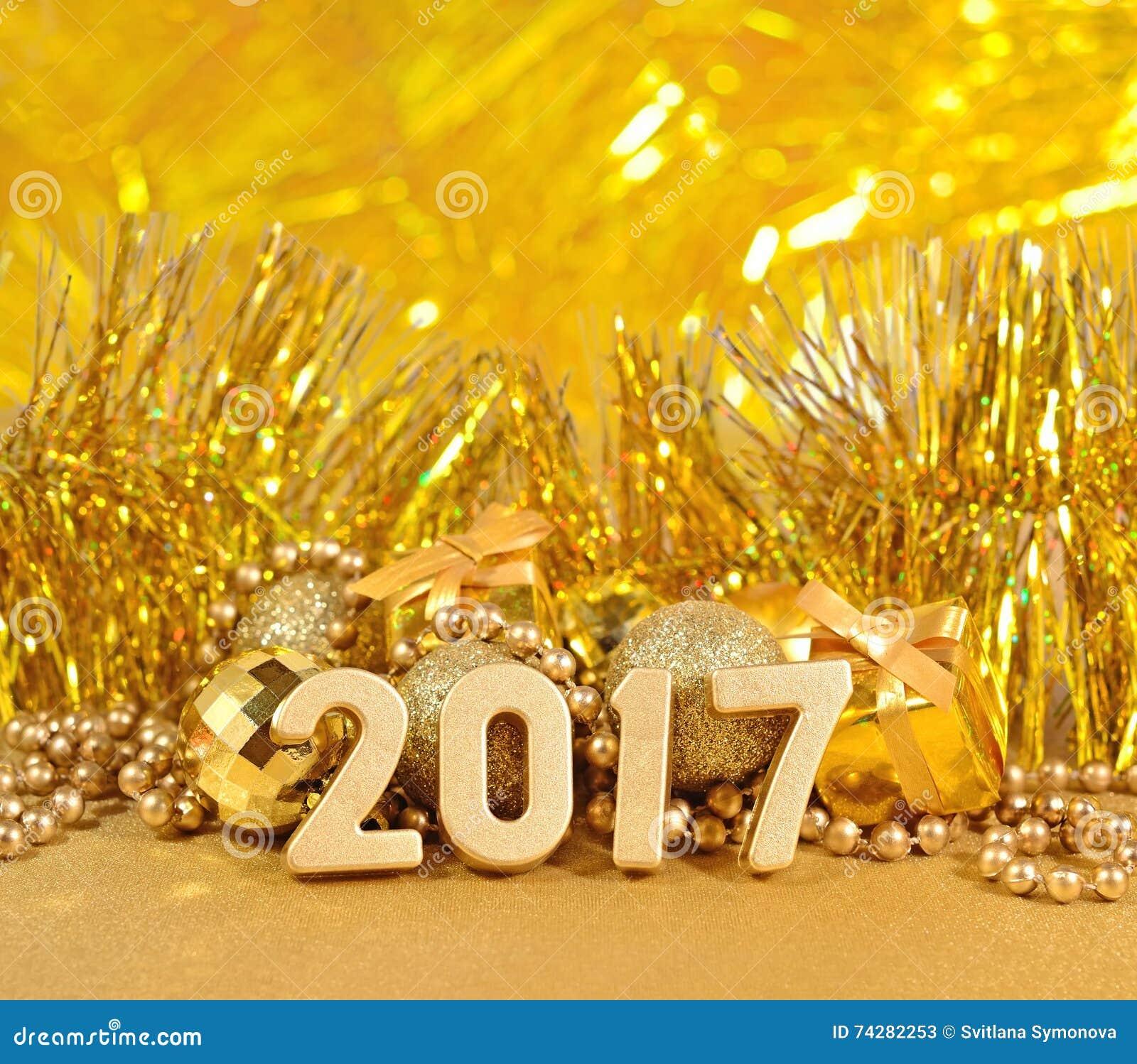 Het jaar gouden cijfers van 2017 en gouden Kerstmisdecoratie