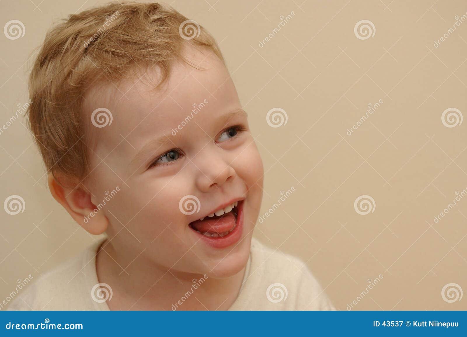 Het lachen van het jonge geitje