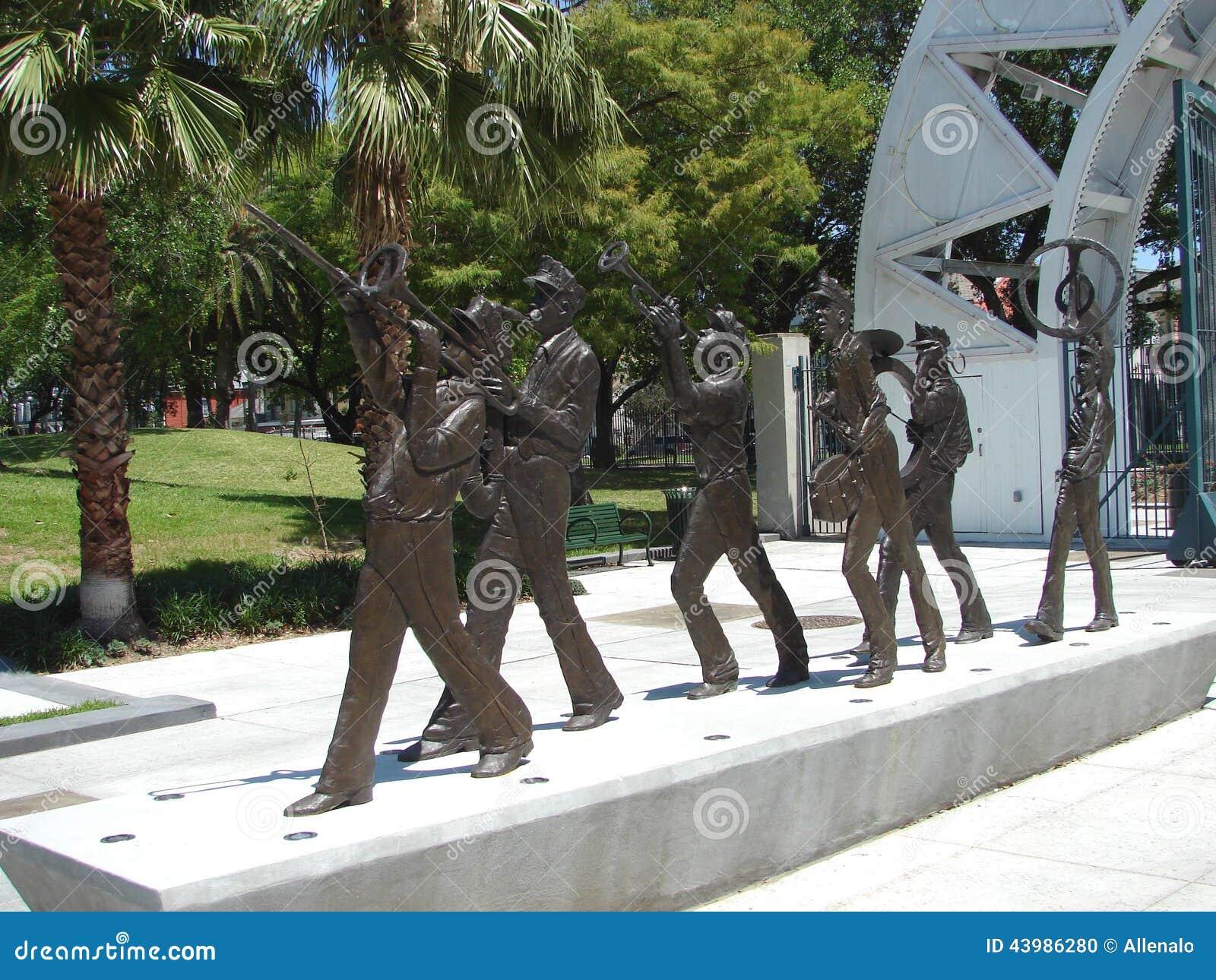 Het Marcheren van New Orleans Fanfarekorpsbeeldhouwwerk in Louis Armstrong Park
