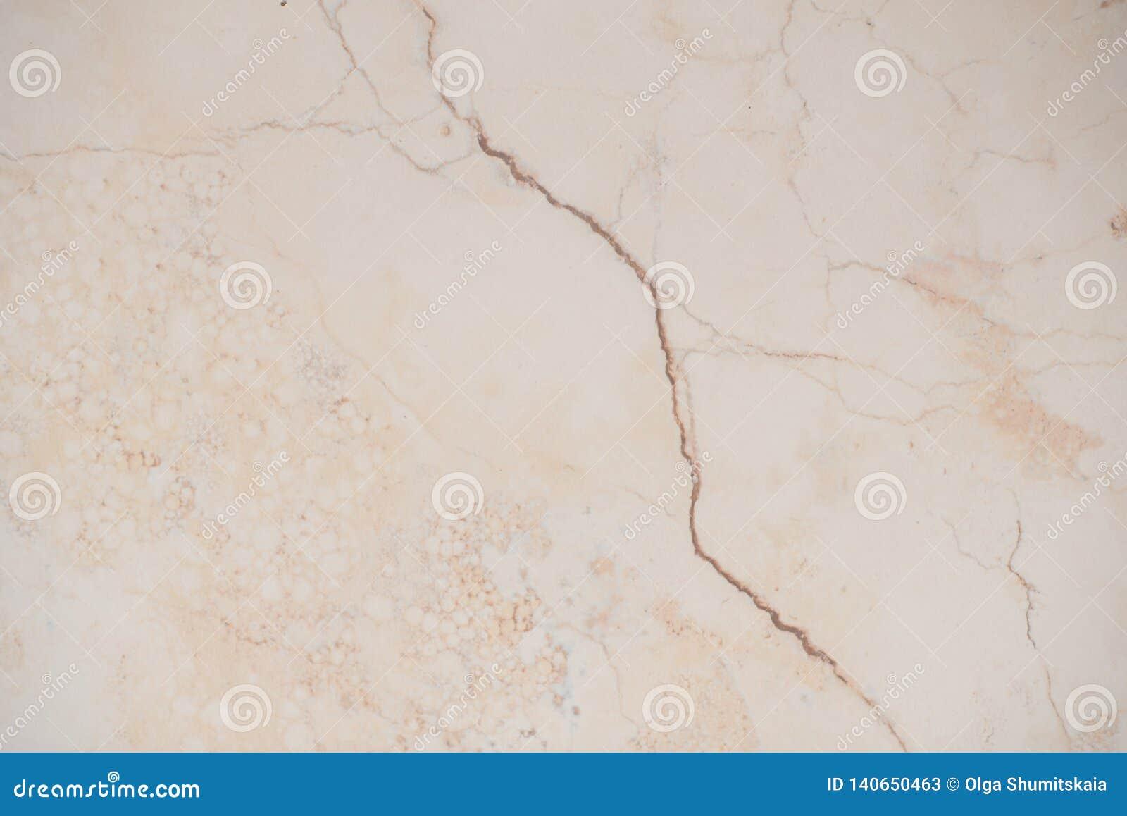 Het marmeren licht van de tegeltextuur op de vloer, patroon, achtergrond
