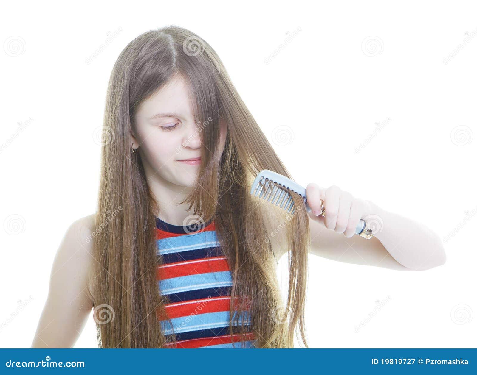 Het meisje dat van de tiener haar lang haar kamt stock afbeelding afbeelding 19819727 - Het versieren van de tiener kamer ...