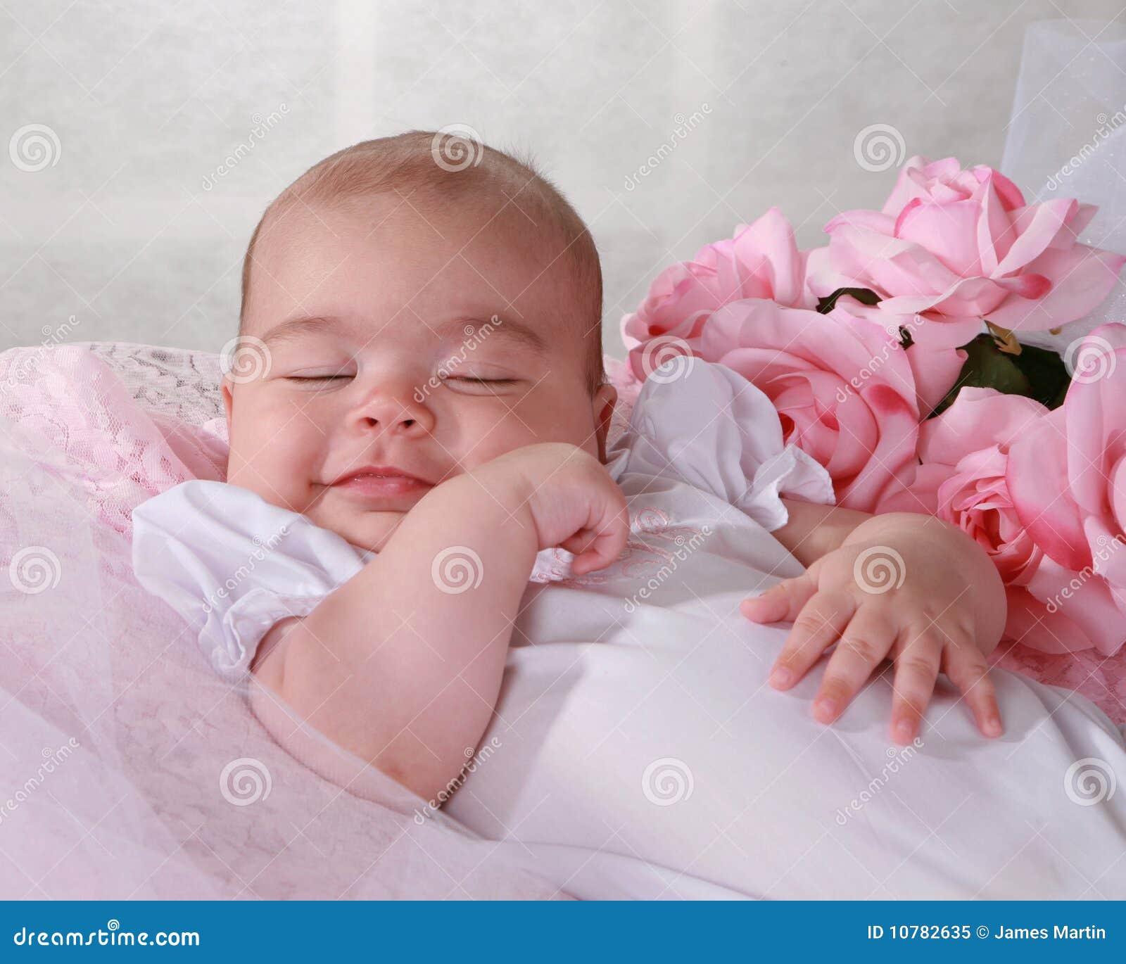 Het meisje van de baby het glimlachen